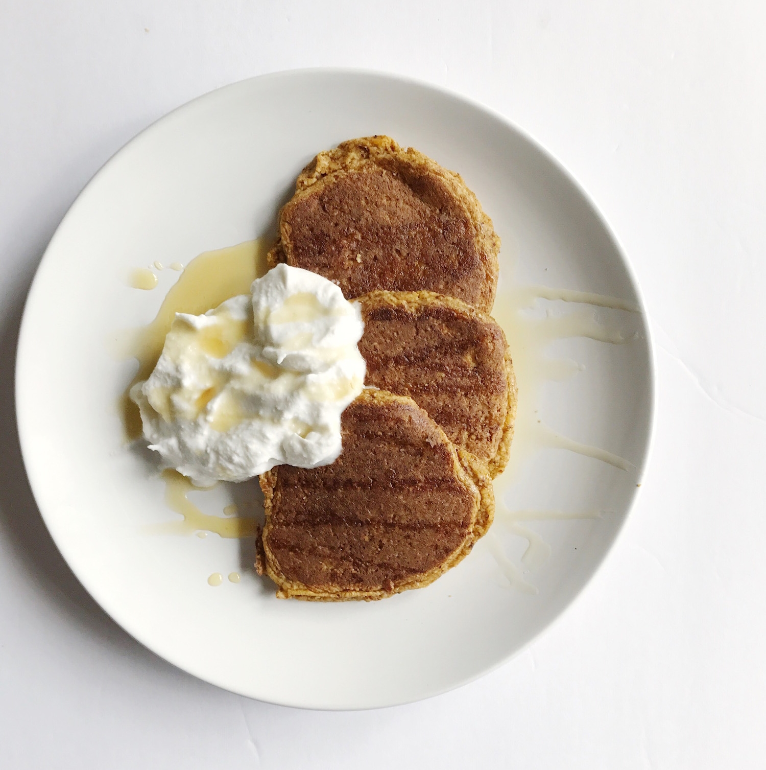 paleo-pumpkin-pancakes-and-coconut-whipped-cream.jpg