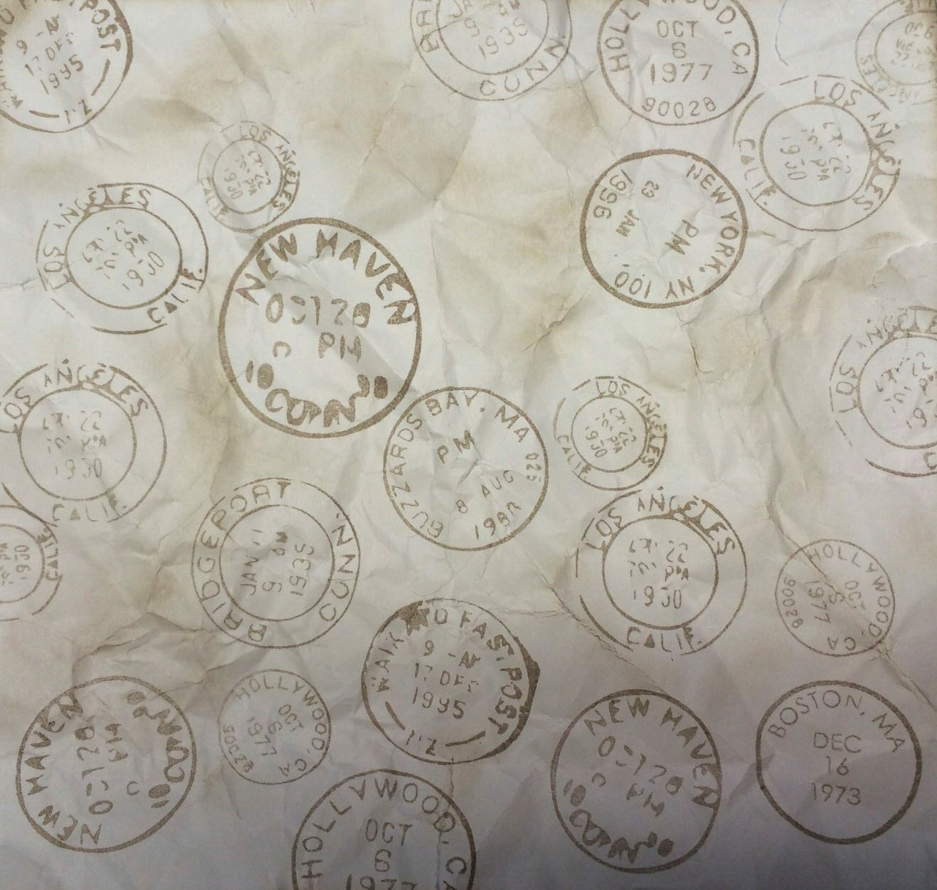 Scrapbook Background Paper with 3D-Printed Stamp. Source: WhiteClouds