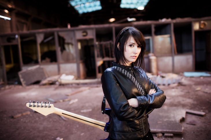 Girl with a guitar in a dilapidated warehouse. Source: Jose AS Reyes/Shutterstock.com