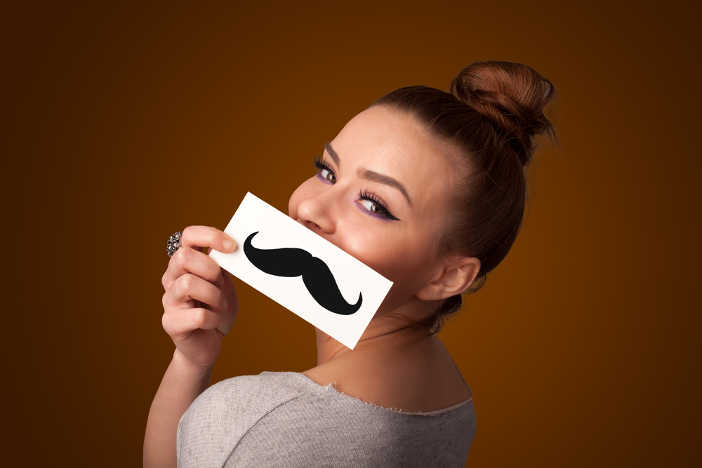 Girl with mustache. Source: ra2media/Shutterstock.com