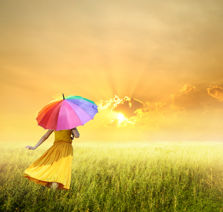 Girl with a rainbow umbrella in a yellow sunny field. Source: FWStudio/Shutterstock.com