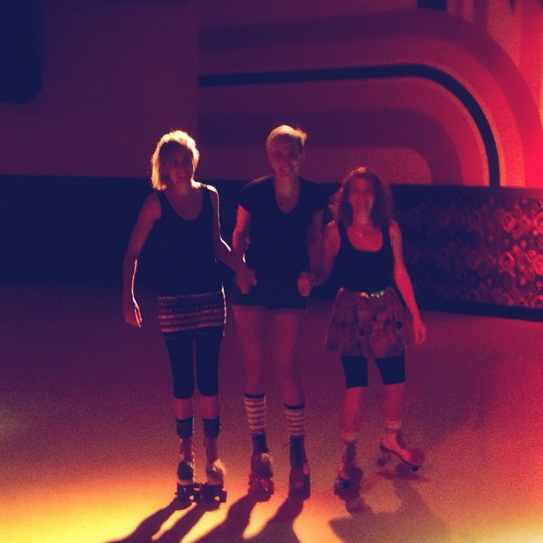 Christi, Christen, and Peanut roller skating at Peanut's 35th birthday party