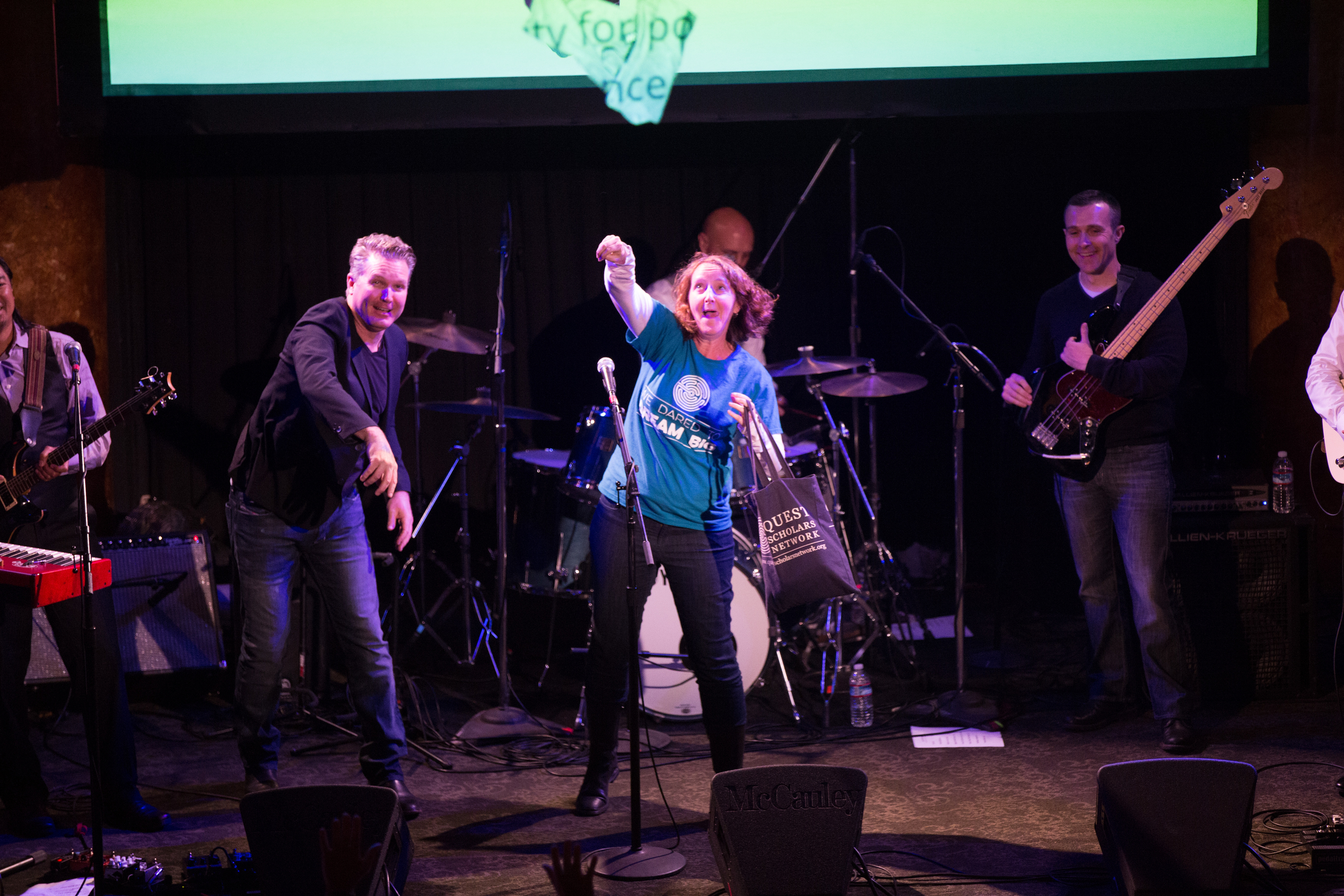 Here our Law Rocks SF emcee and the nonprofit representative from QuestBridge throw swag into the crowd. QuestBridge was the nonprofit pick of the humorously named LawrJe$$ & the Big Legal Instruments (Gibson, Dunn & Crutcher; King & Spalding; Mallari Advisory Services).