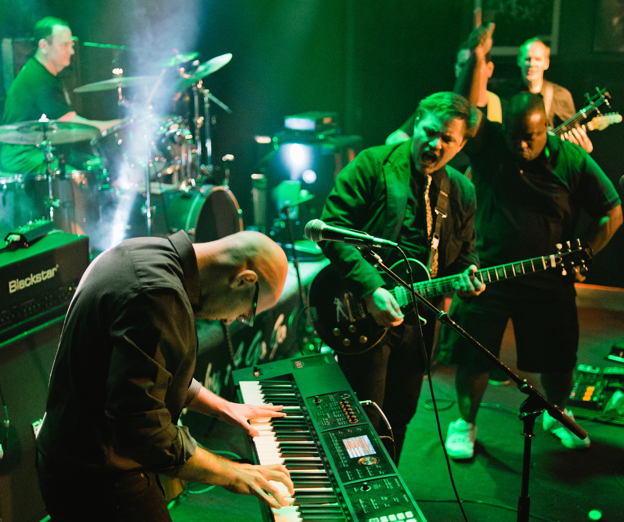 The members of Down By Law (Reed Smith; Constangy, Brooks, Smith & Prophete) enthusiastically give it up for their keyboardist as they rock for LACBA Counsel for Justice at Law Rocks LA.