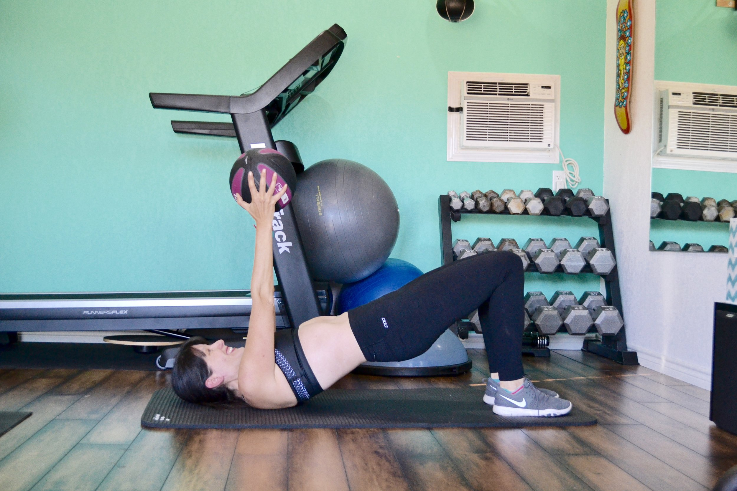 medicine ball bridge with chest press
