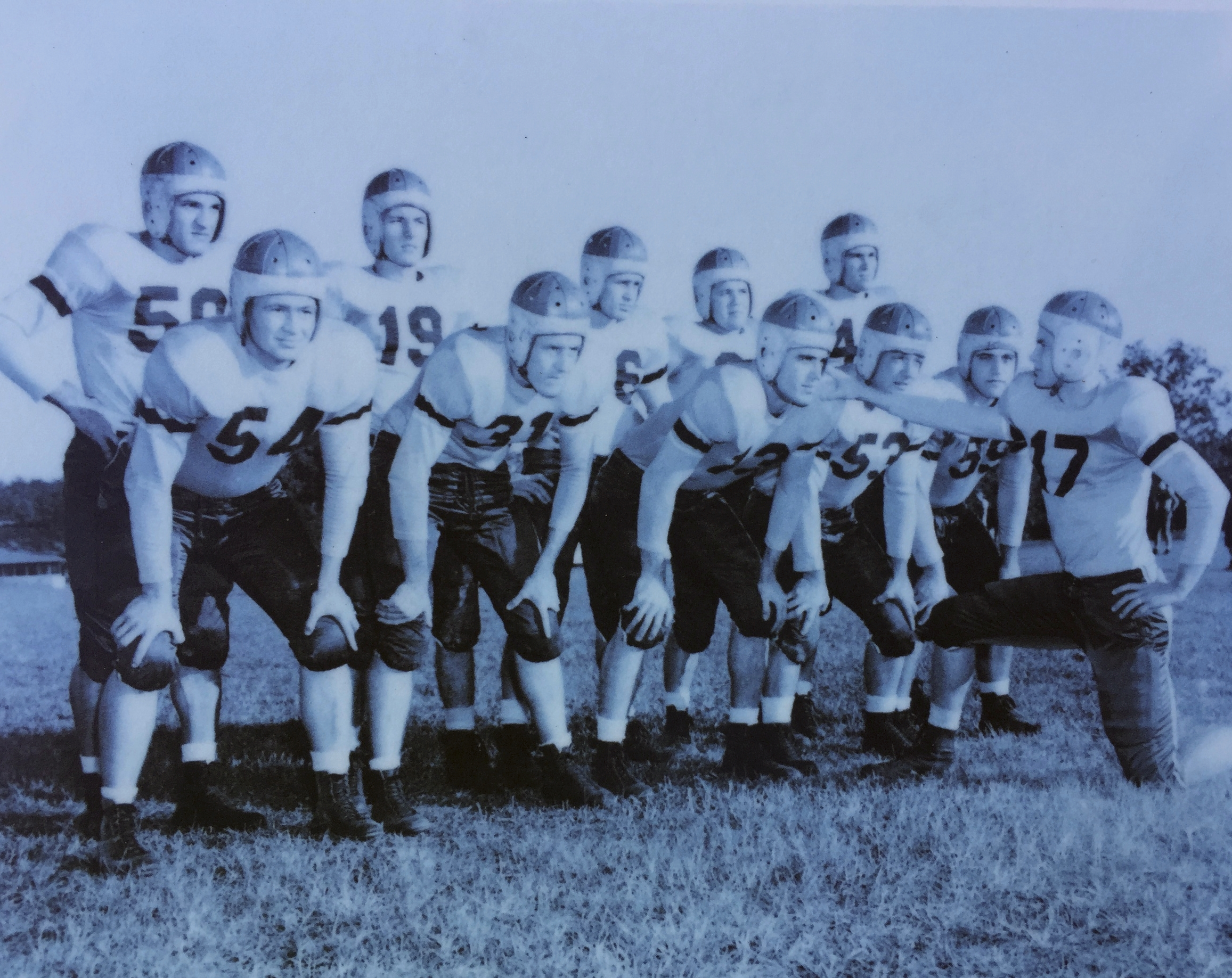 That's my dad, number 13, bent over on the first row with the quarterback's hand on his shoulder pad. He loved sports more than anything and spent many happy hours playing at the old Centennial Field. Dad was captain of the first men'sbasketball team at FSU which had just gone co-ed and  an all star athlete at Leon High School, which my son now attends.