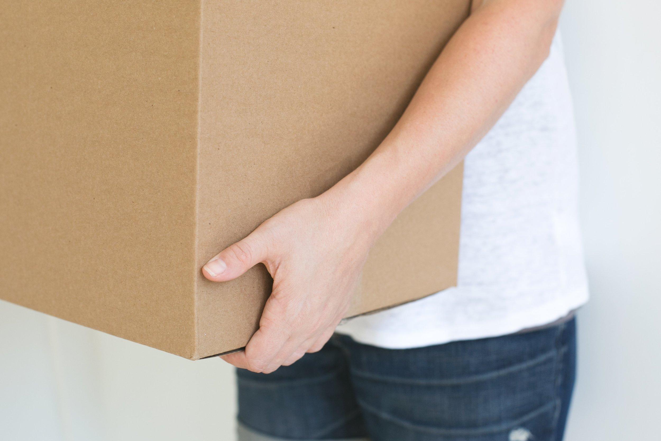 person-holding-box.jpg
