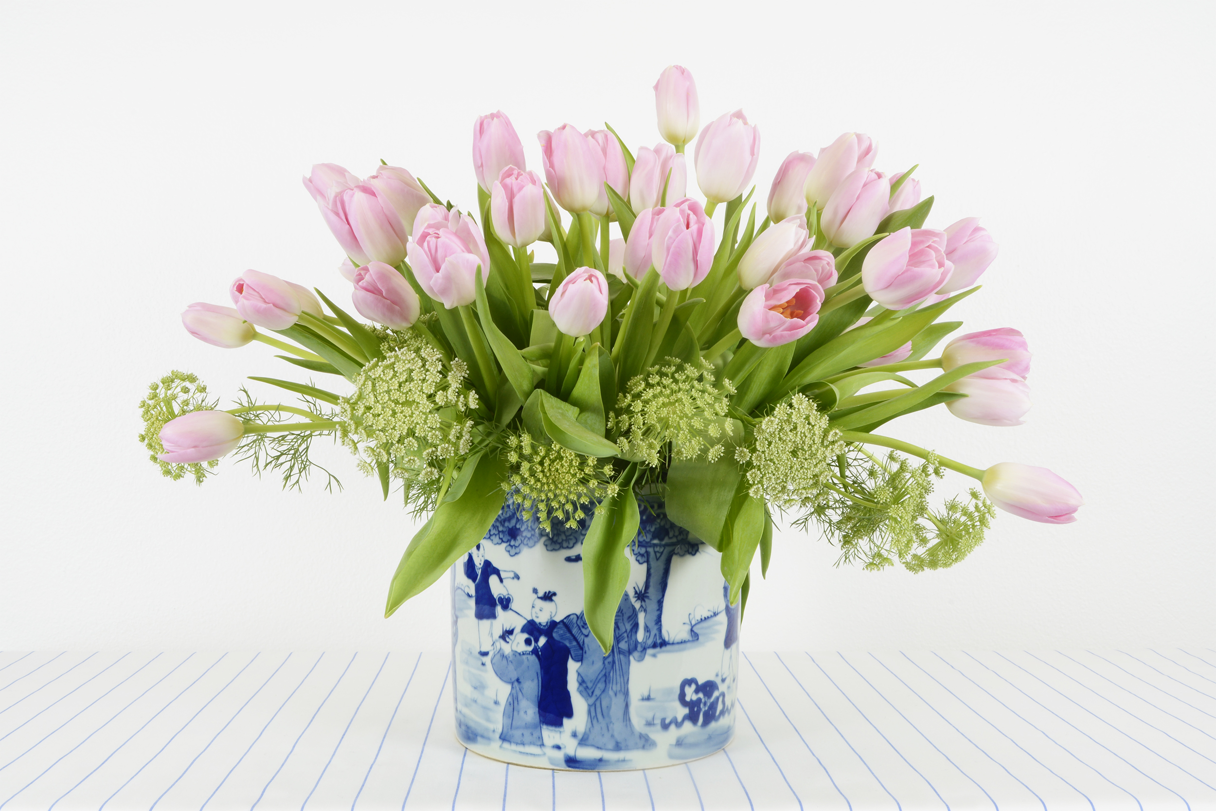 site image pink tulips in blue and white vase sized.jpg