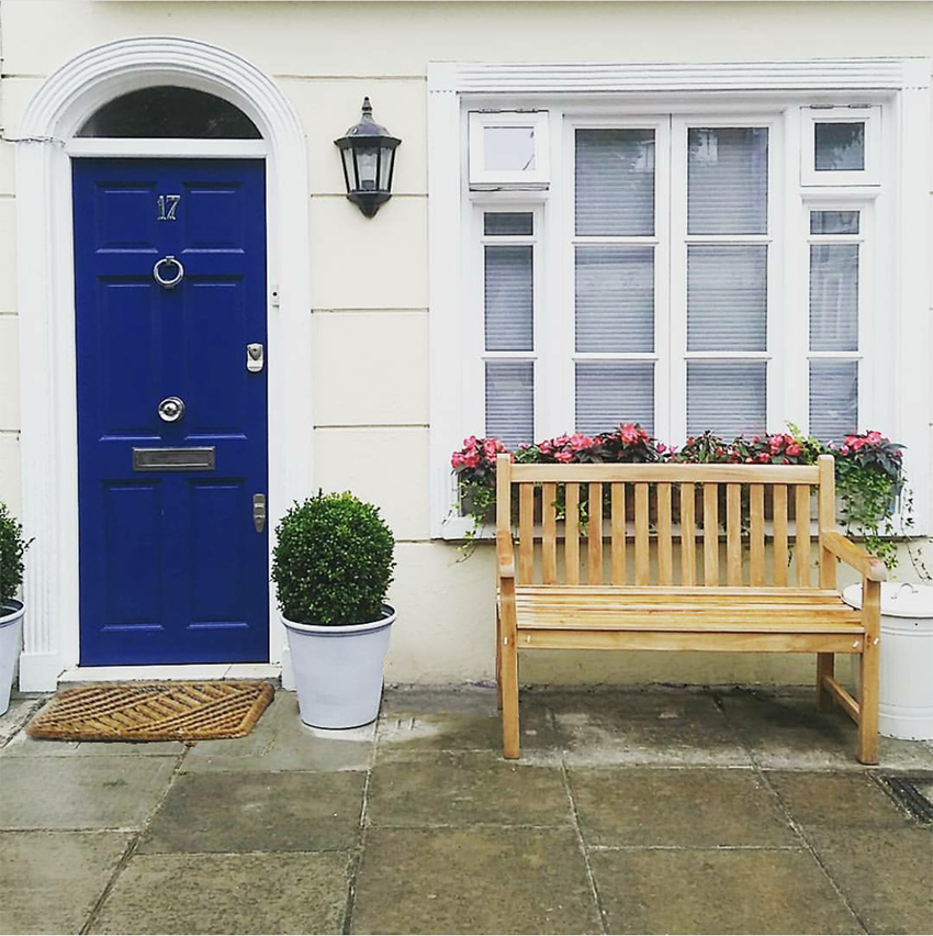 gorgeous front door in blue with boxwood