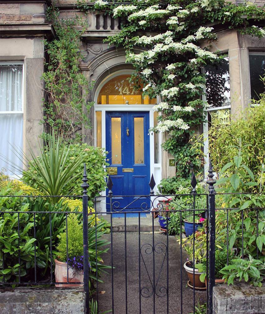 blue front door and garden