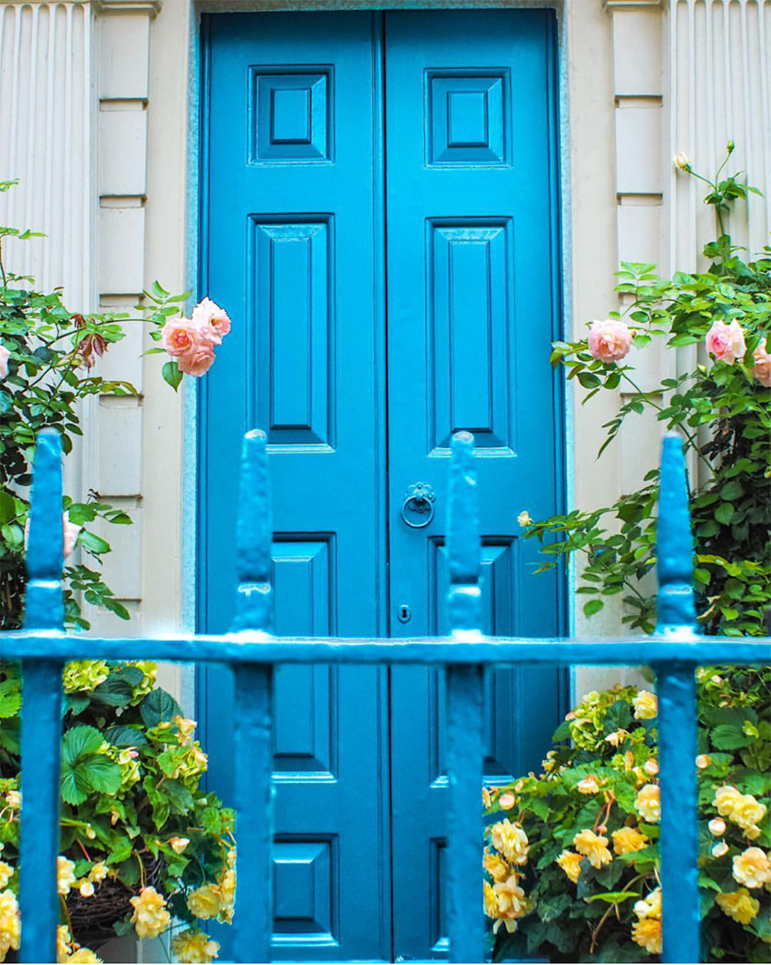 turquoise blue front door with blue gate