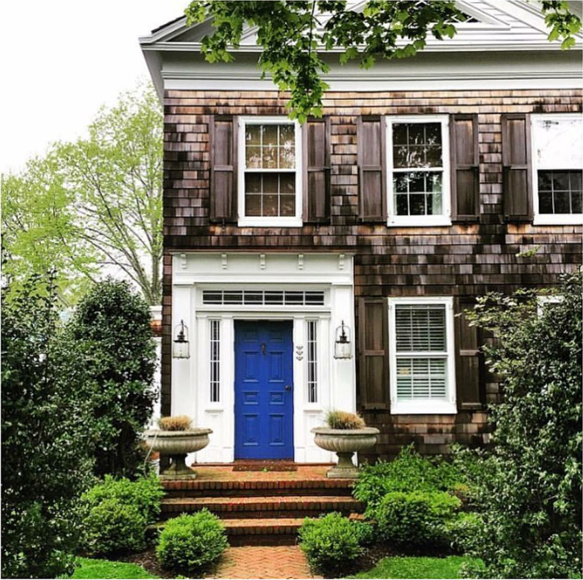 blue front door on New England style shingled house