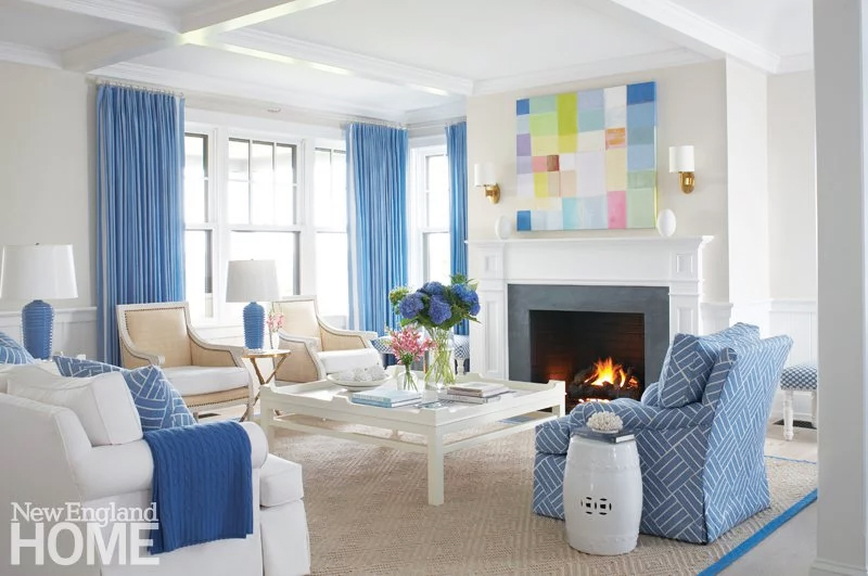 Blue hydrangeas, blue and white fabric, a gorgeous Oomph coffee table, and a fun, colorful painting by Ben Georgia in this lovely Nantucket getaway designed by Lynn Morgan