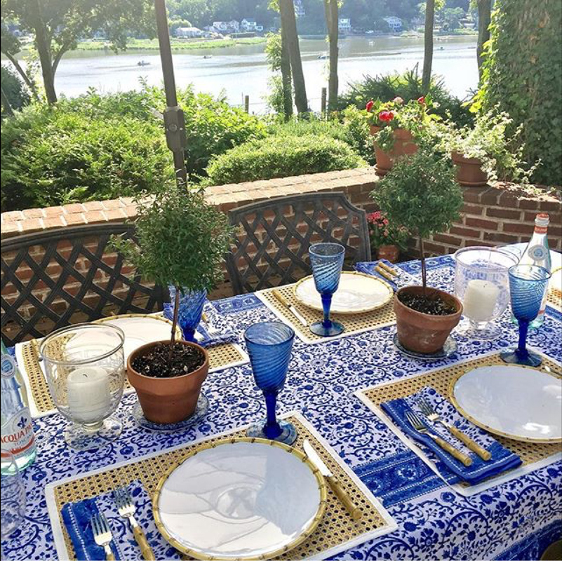 Gorgeous blue and white outdoor tabletop by interior designer Amal Kapen.