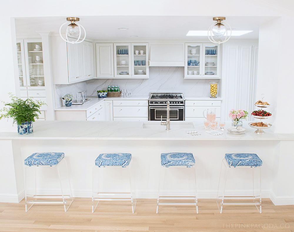 Kitchen and family room renovation for the Fall 2017 One Room Challenge™ with Silestone, Cliqstudios, Hansgrohe, Wisteria counterstools, Bertazzoni range, and Craftmade pendants.