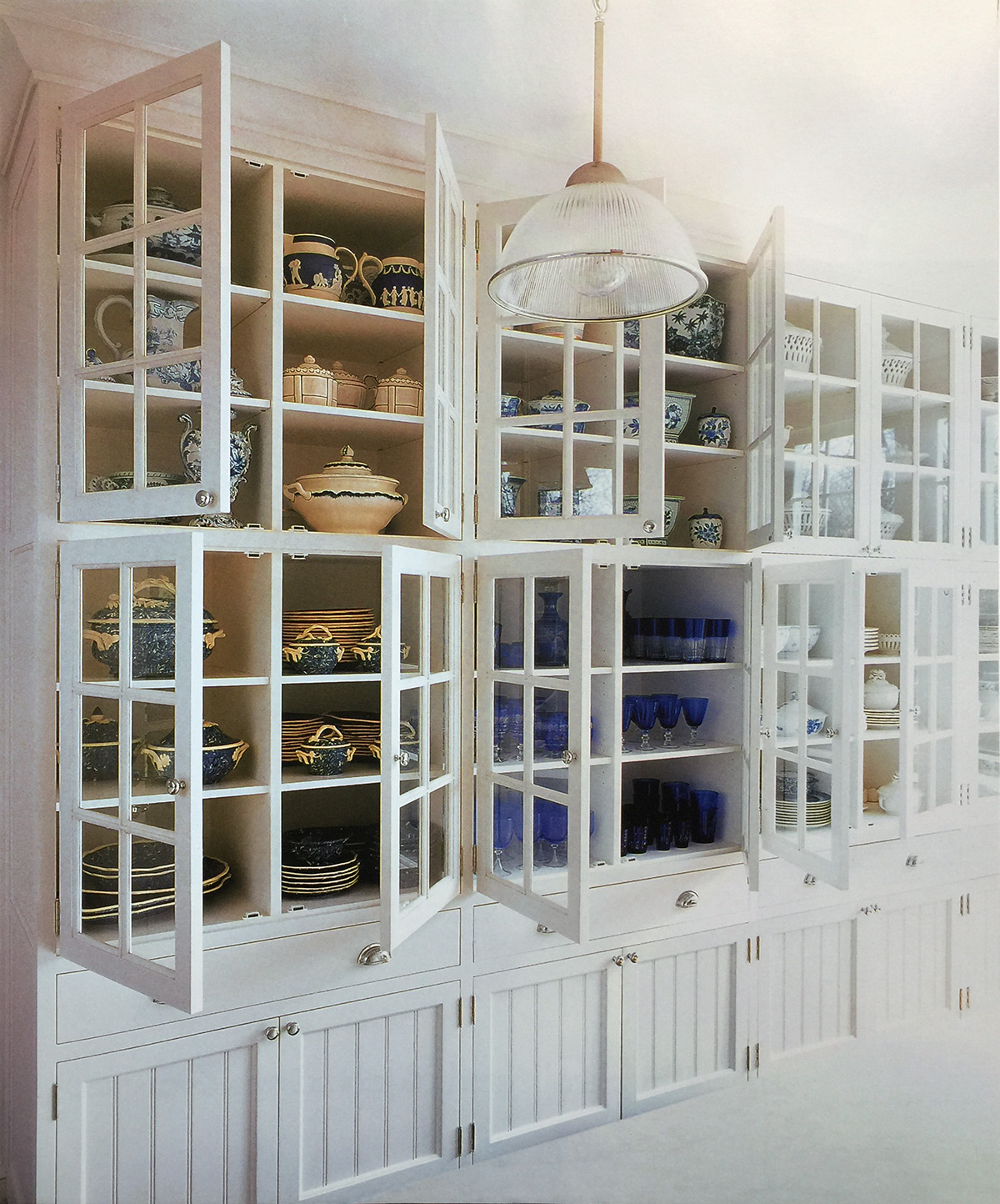 Carolyne Roehm's beadboard cabinets that house her extensive collection of blue and white porcelain, ceramics and glassware.
