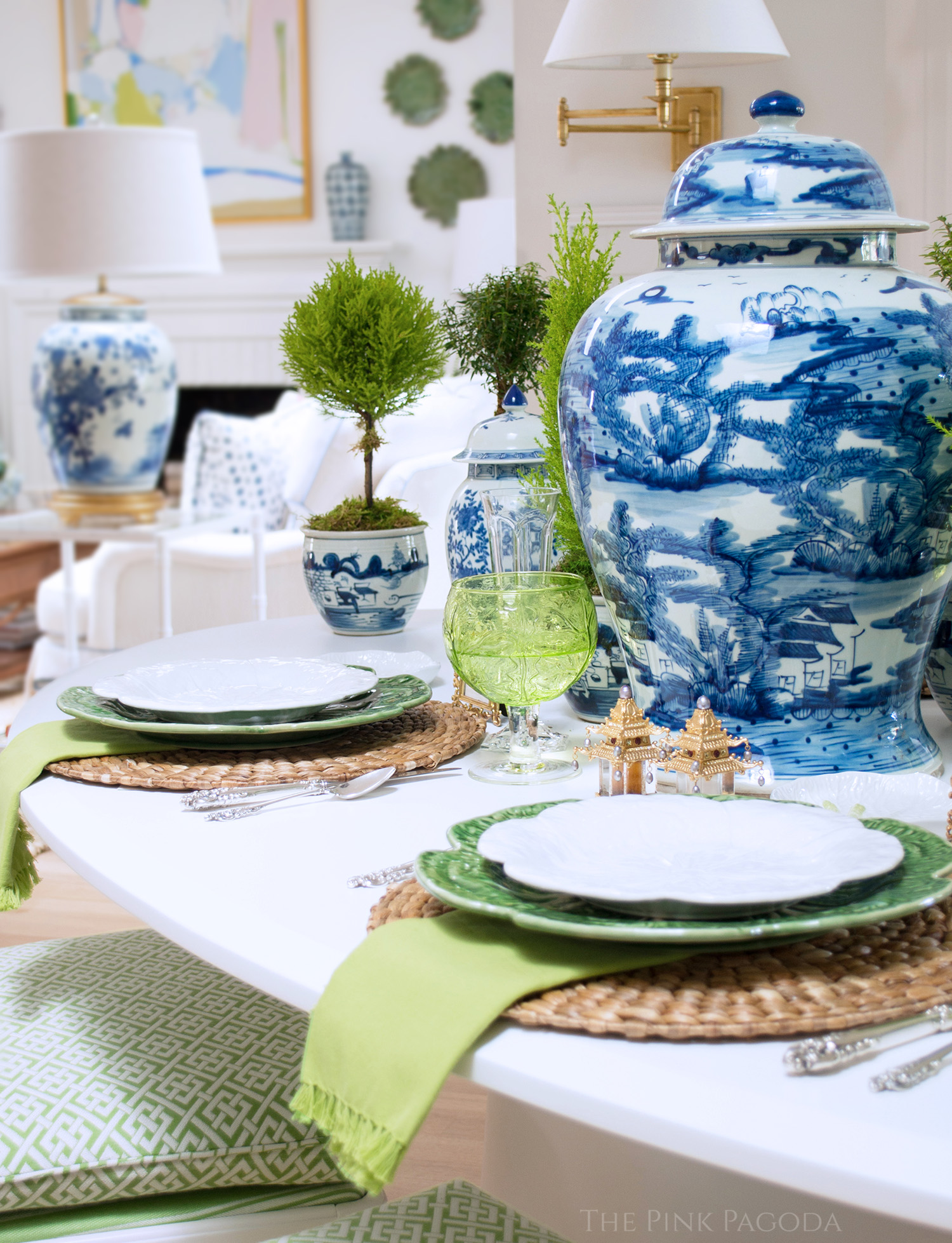 Breakfast table in The Pink Pagoda's Fall 2017 One Room Challenge™ with topiaries, Bordallo Pinheiro green cabbage dinnerware, L'objet accessories, and blue and white ginger jars.
