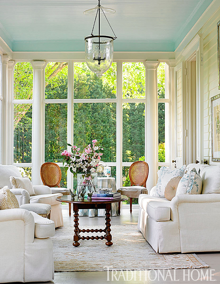 Single paned windows in a sunroom with a blue ceiling.
