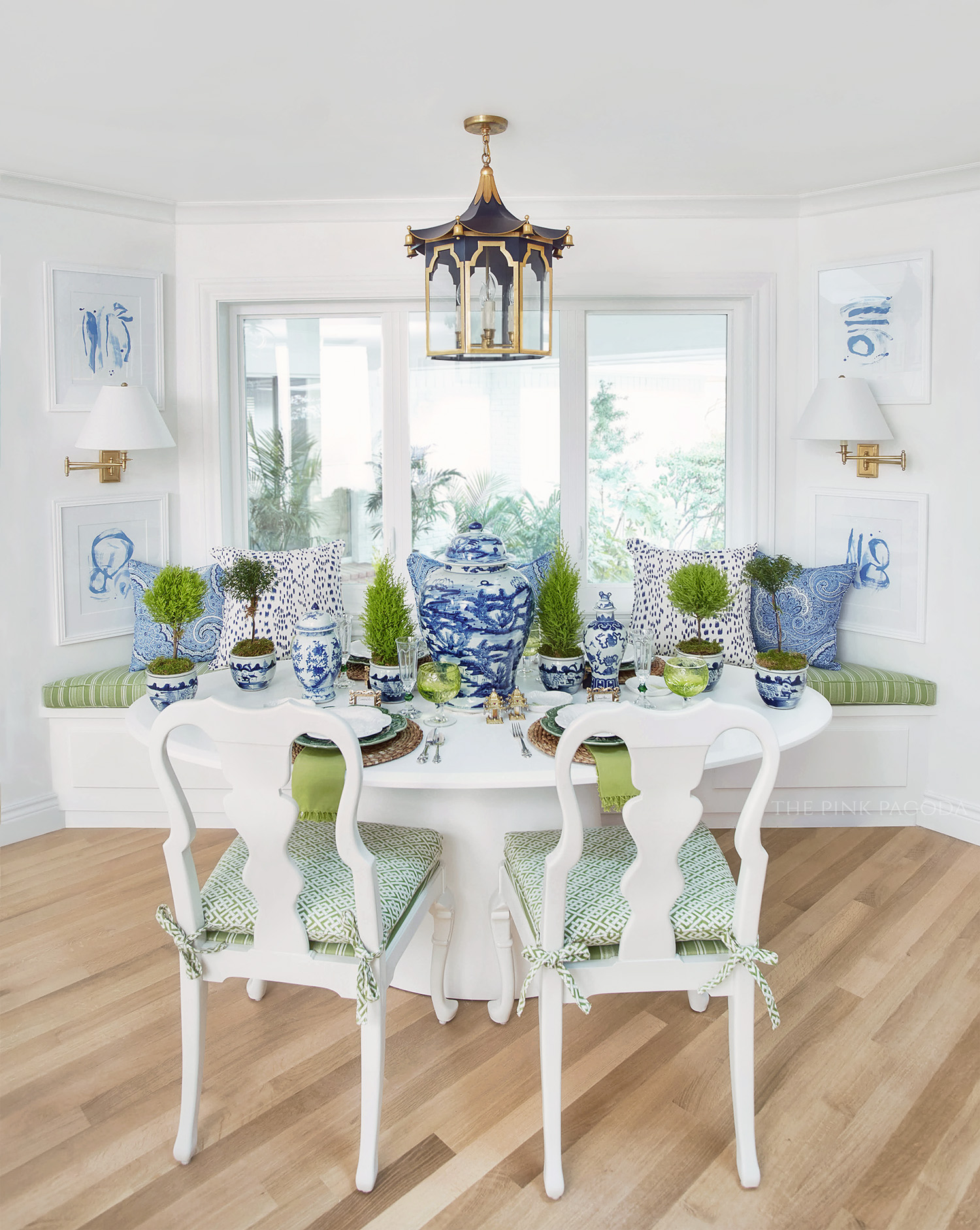 Replacement windows from Milgard was one of the updates included in The Pink Pagoda's One Room Challenge™.  The clean casement windows are perfect behind the banquette and look gorgeous flanked by Christina Baker's blue and white paper pieces.