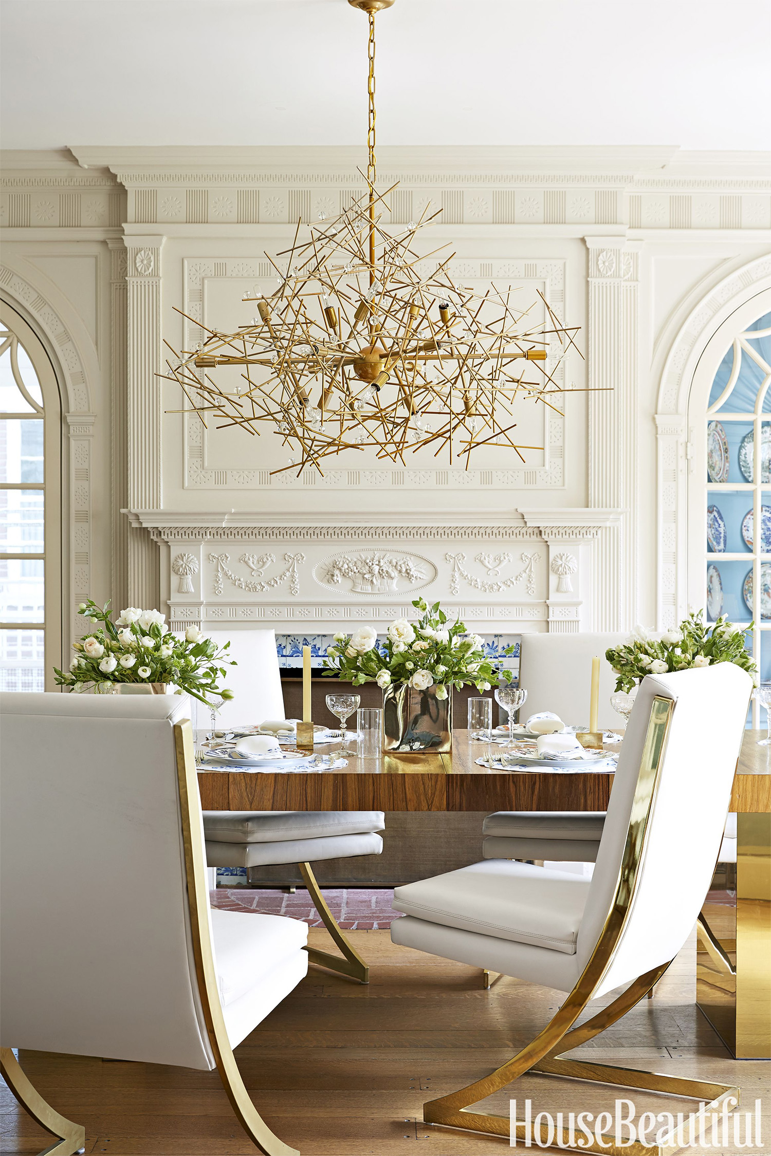 This Janet Gridley designed dining room creates interesting juxtaposition with the home's fireplace and mouldings combined with the chandelier, table, and chairs.