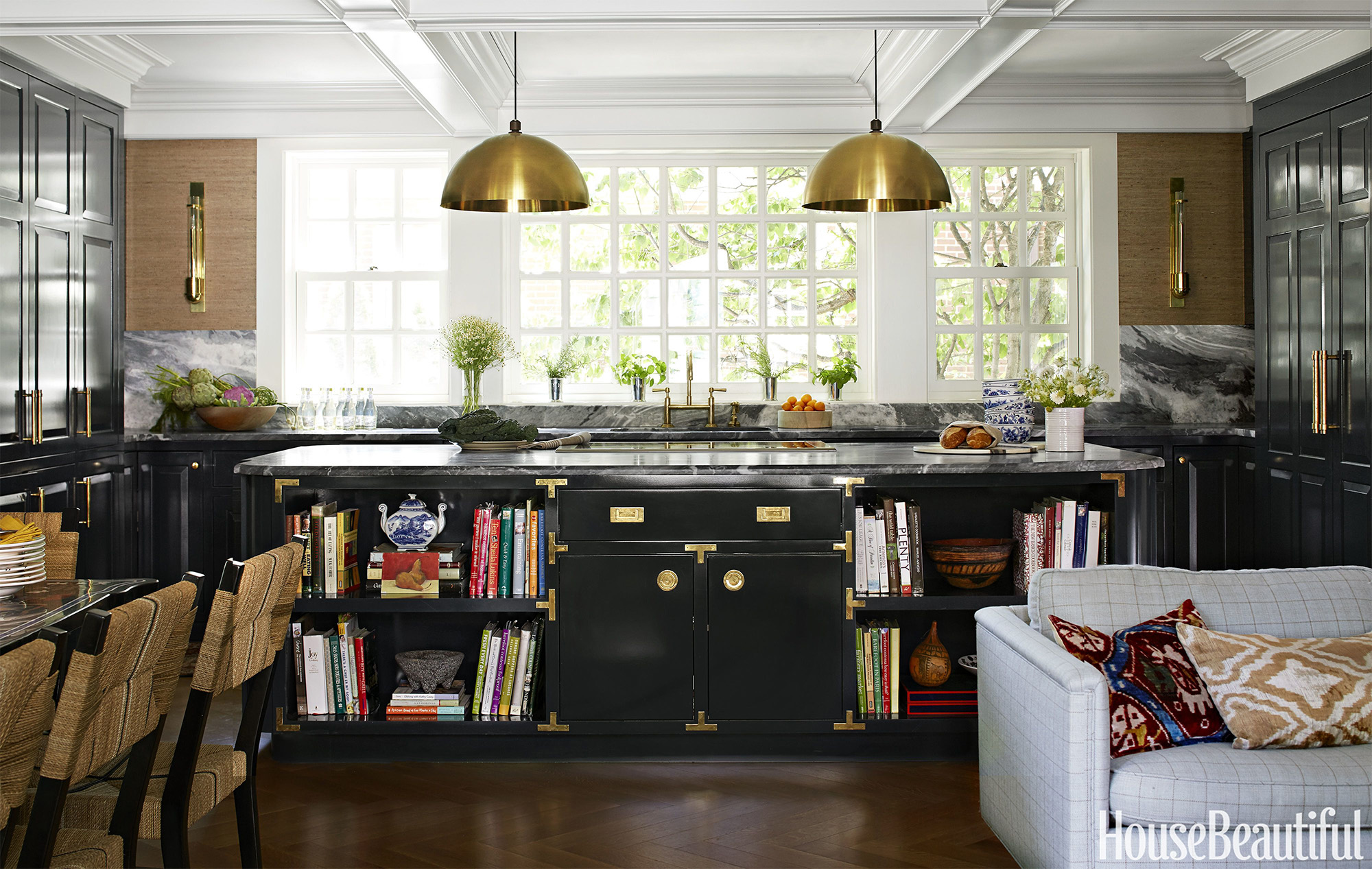 Spectacular black lacquered campaign style island anchors this gorgeous Janet Gridley kitchen.