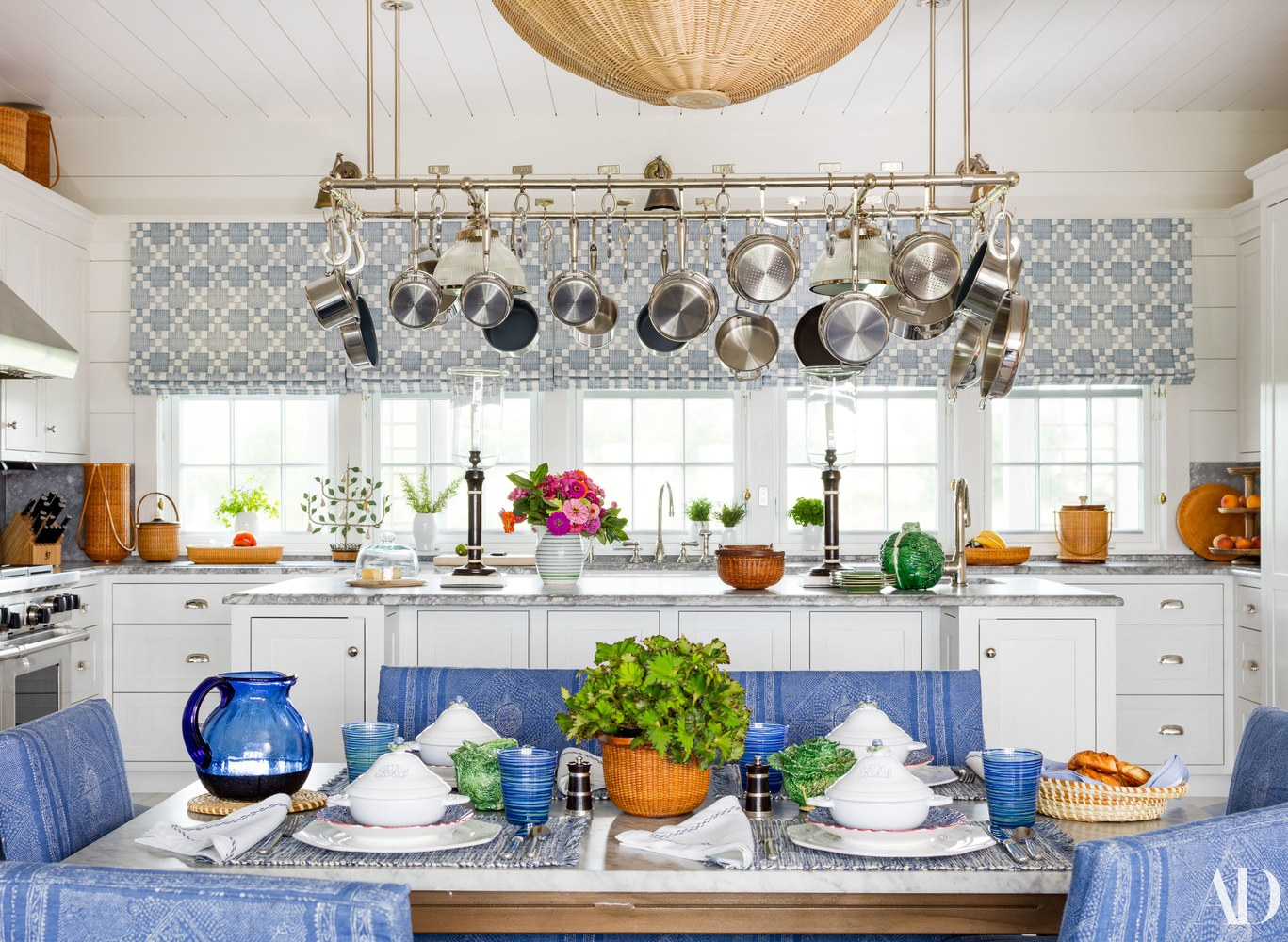 Charming and cheerfully designed Nantucket kitchen by Markham Roberts.