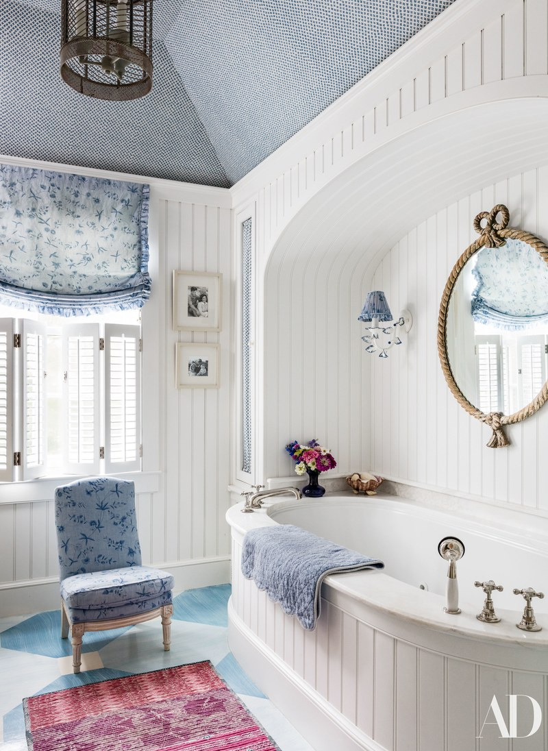 Markham Roberts designed this charming bath.  LOVE the blue patterned floor.