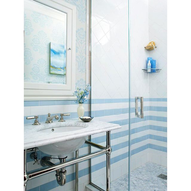 Focusing on the bath over here at TPP.  For the @oneroomchallenge, I'm transforming a jack and Jill bathroom straight out of 1969.  Click through my profile to be taken back in time : ). I'm busy looking at inspiration, and this bath, designed by @santhonyinteriors and Maureen Wright, is such a favorite.  While blue and white is always lovely, my daughter asked for pink, and so pink it is.  Hope you'll follow along with the adventure! . . . . #bath #bathroom #blueandwhiteforever #blueandwhite #ceramictile #stripes #interiors #classicdesign #thepinkpagoda #oneroomchallenge #bhgorc