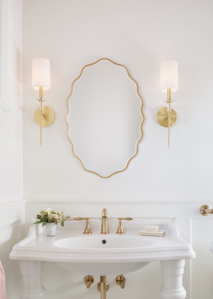 Brass and Crystal Hudson Valley Lighting Amherst sconces in a powder room