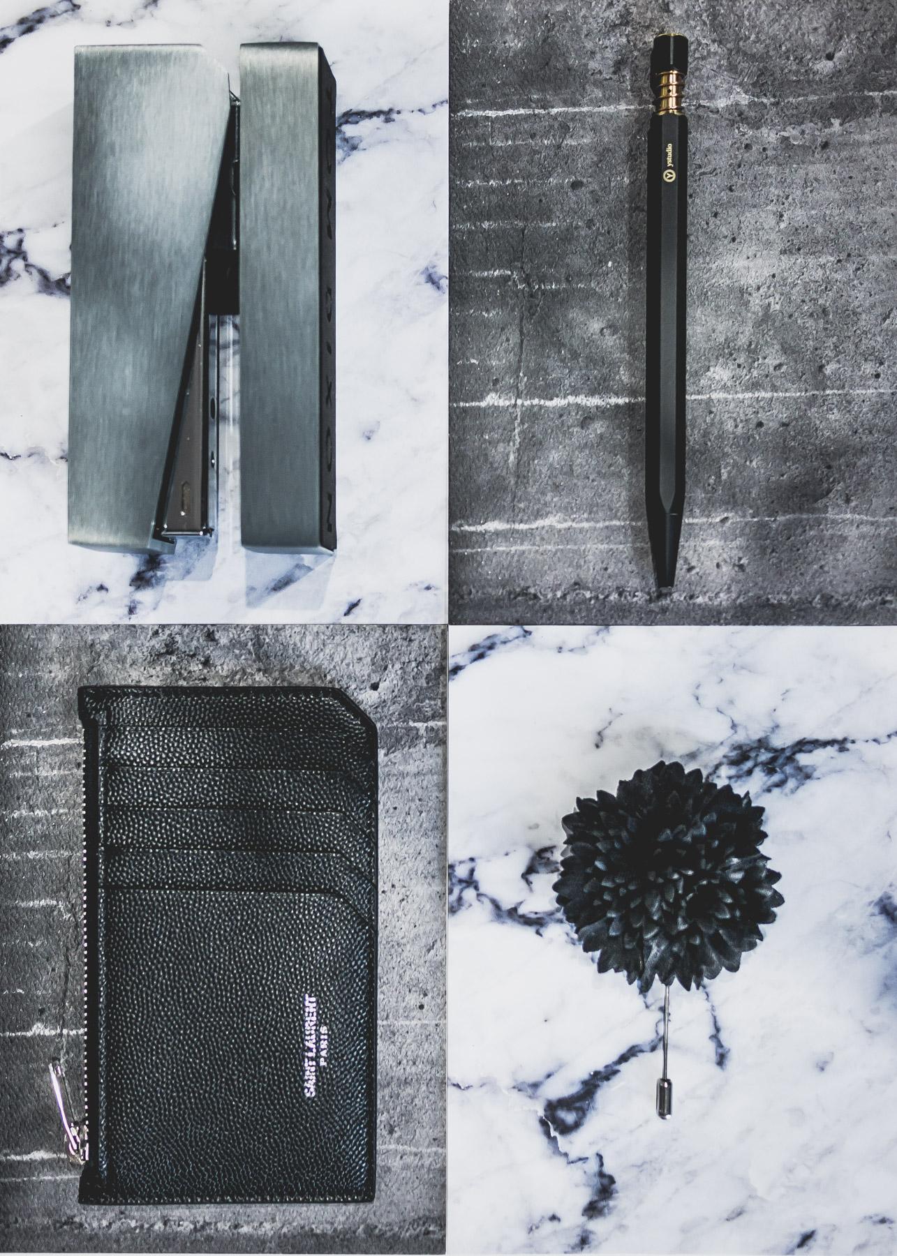 The perfect stocking stuffers:   Tom Dixon Brushed Silver Cube Stapler  ,   YStudio Brass Ballpoint Pen  ,  Saint Laurent Pebble-Grain Leather Cardholder  ,   Lanvin Woven Flower Lapel Pin