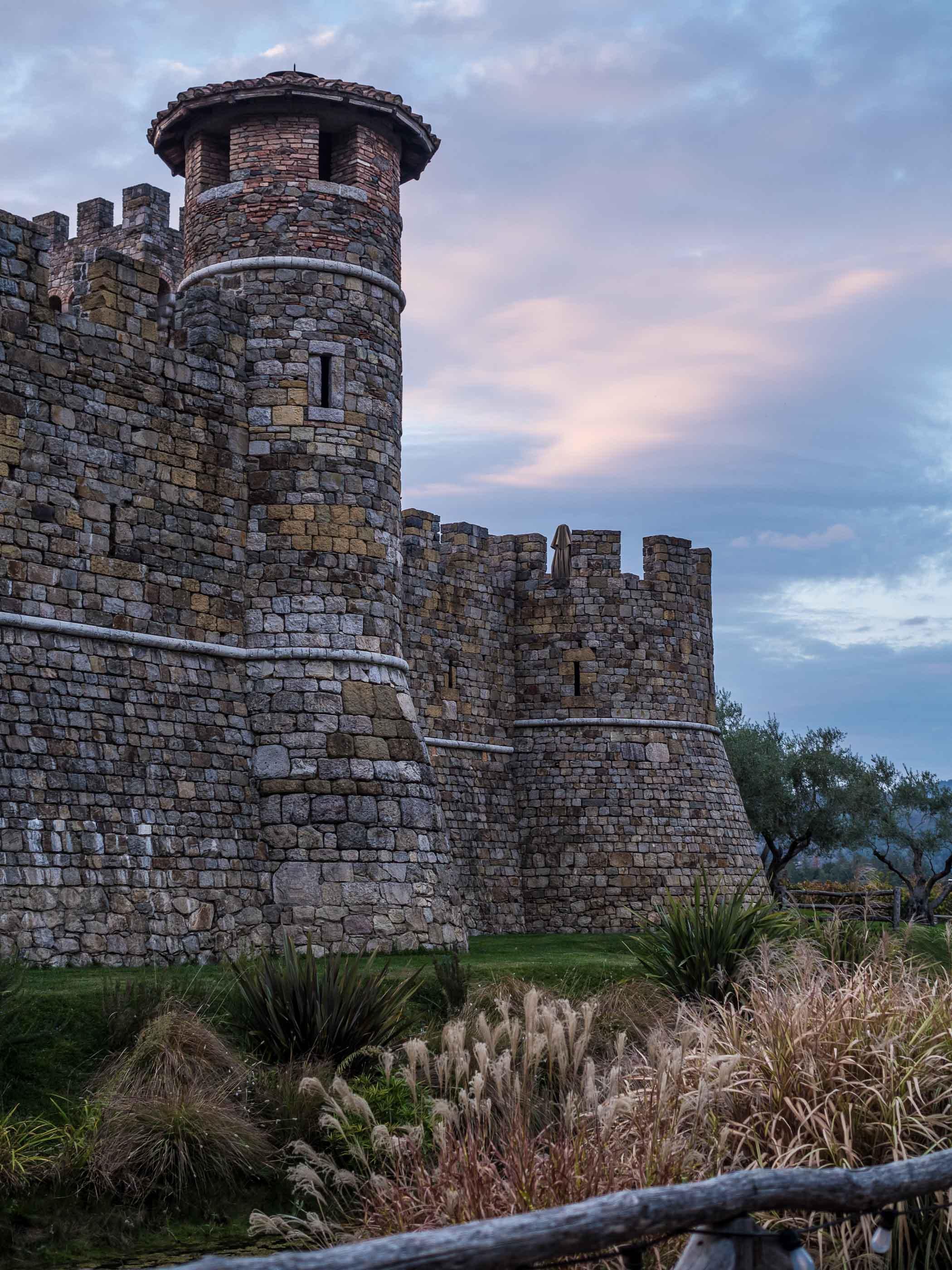The Castello di Amorosa wine estate at dusk.