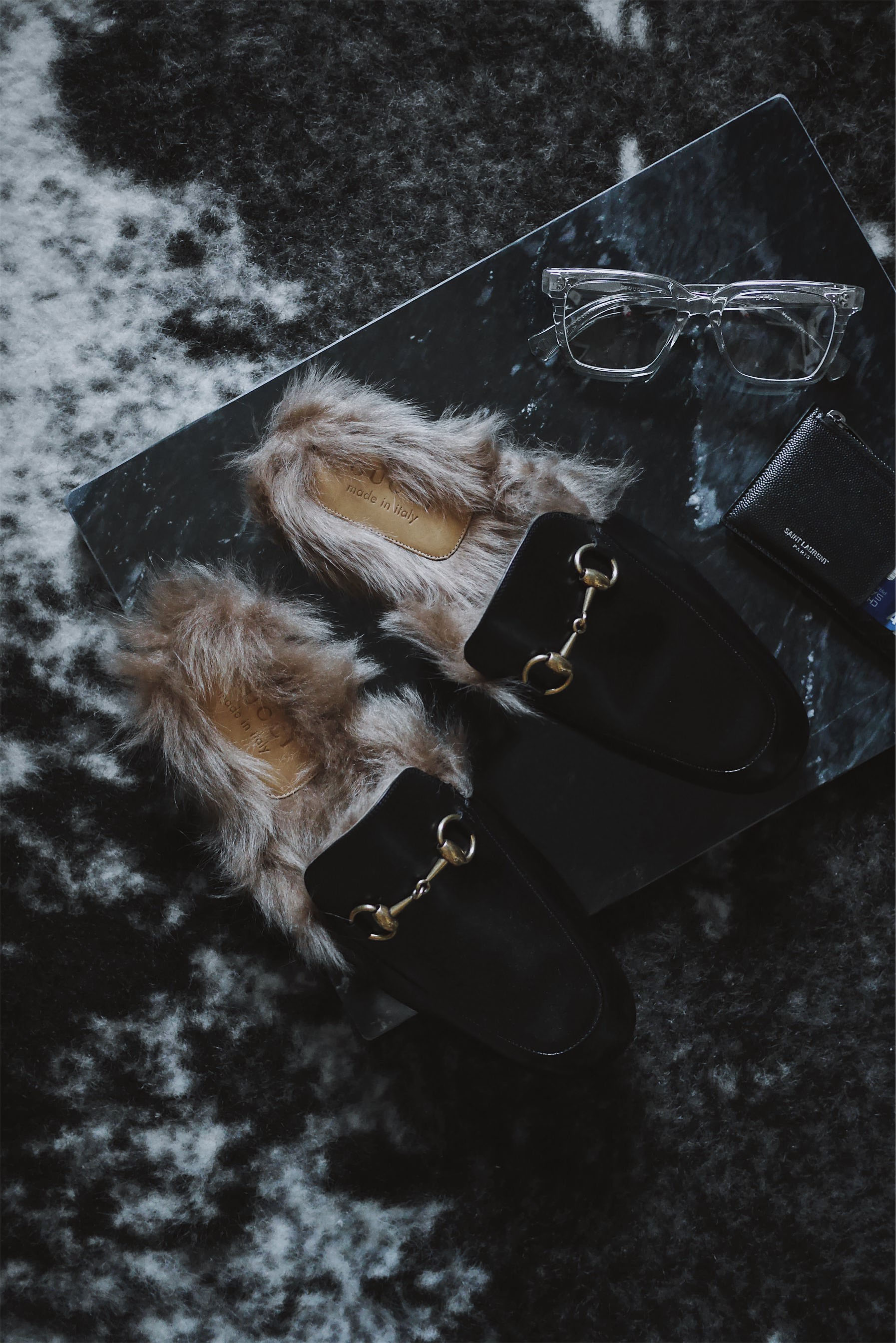 Fur-ocious loafers for your voracious appetite  - Put your best foot forward with two of my favorite fur loafers from Gucci + Prada.