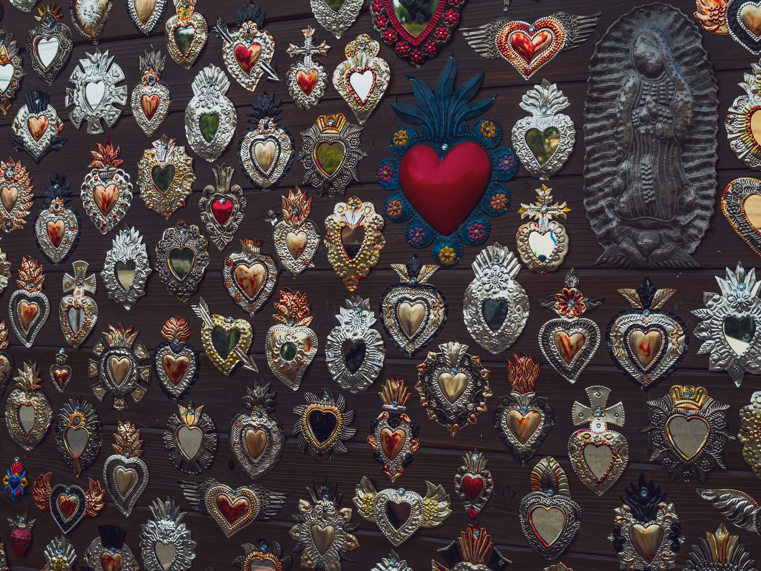 The wall decor outside of Mi Corazon is such a distinctly-Spanish take on the heart wall
