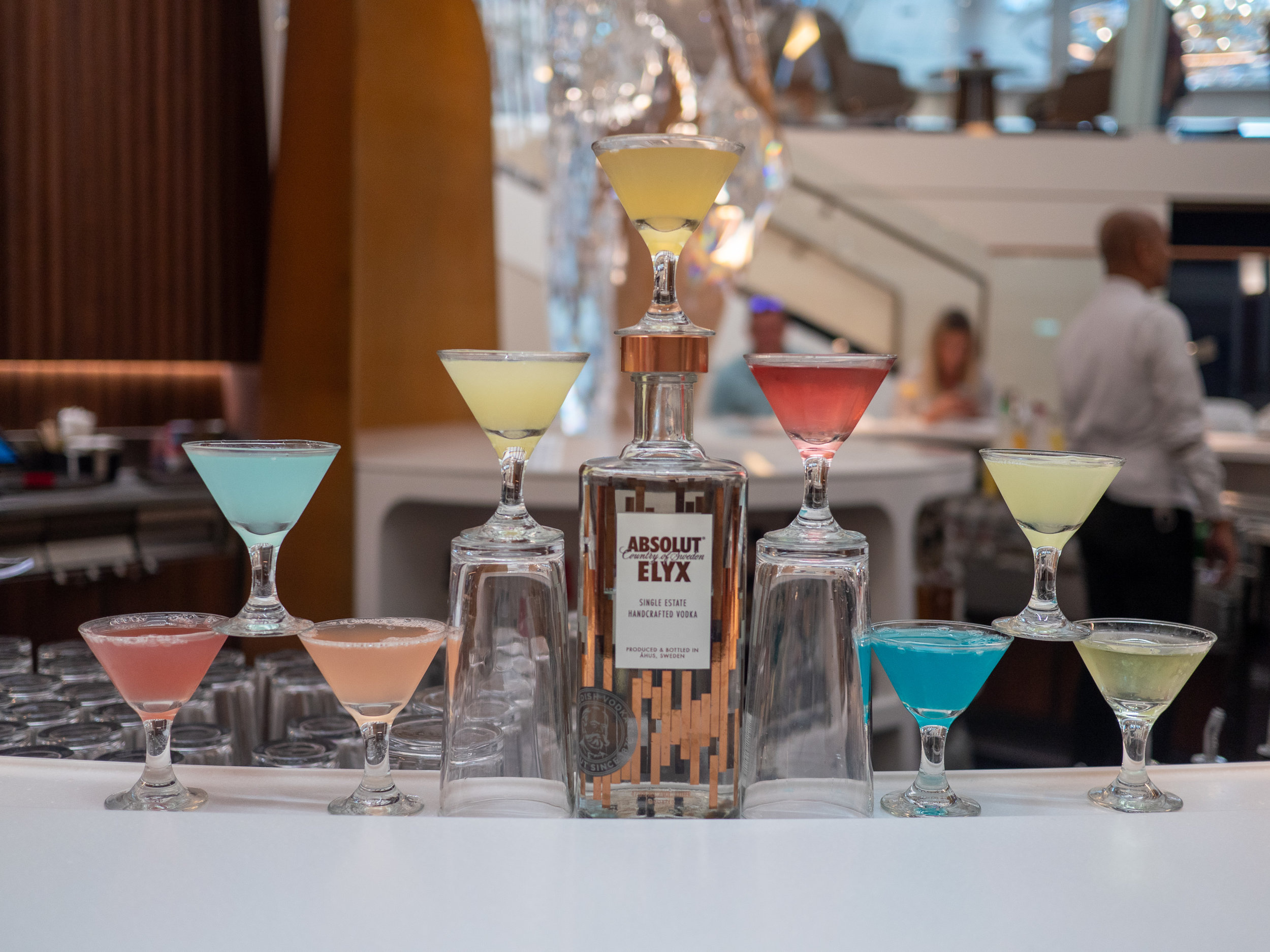 A tasty flight of Absolut Elyx cocktails is just…one of many artisanal mixology surprises you can expect while on board!