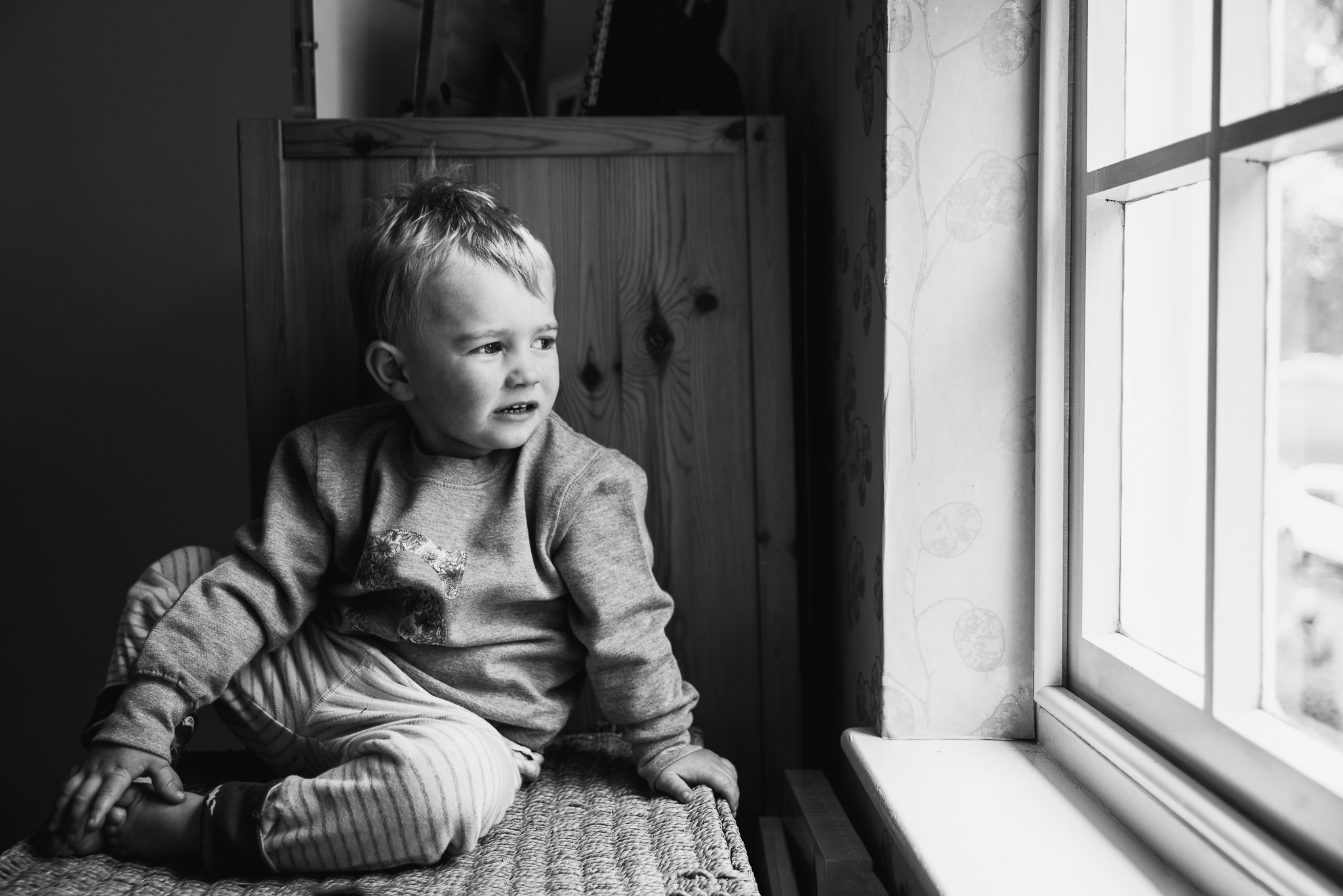 Toddler in window light.
