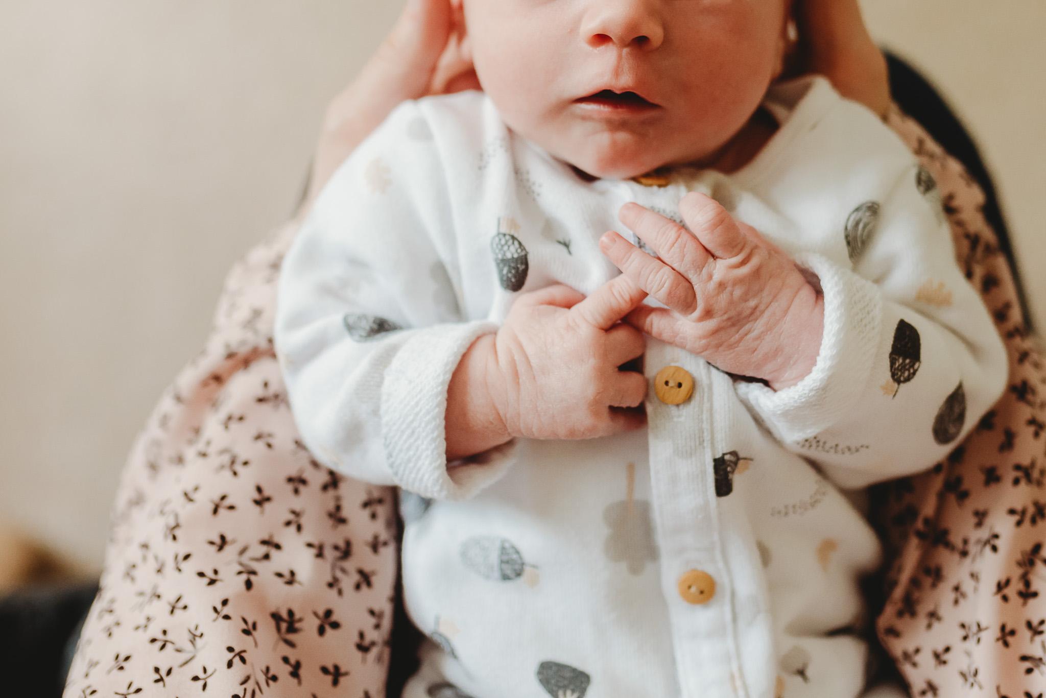 Tiny little newborn fingers.