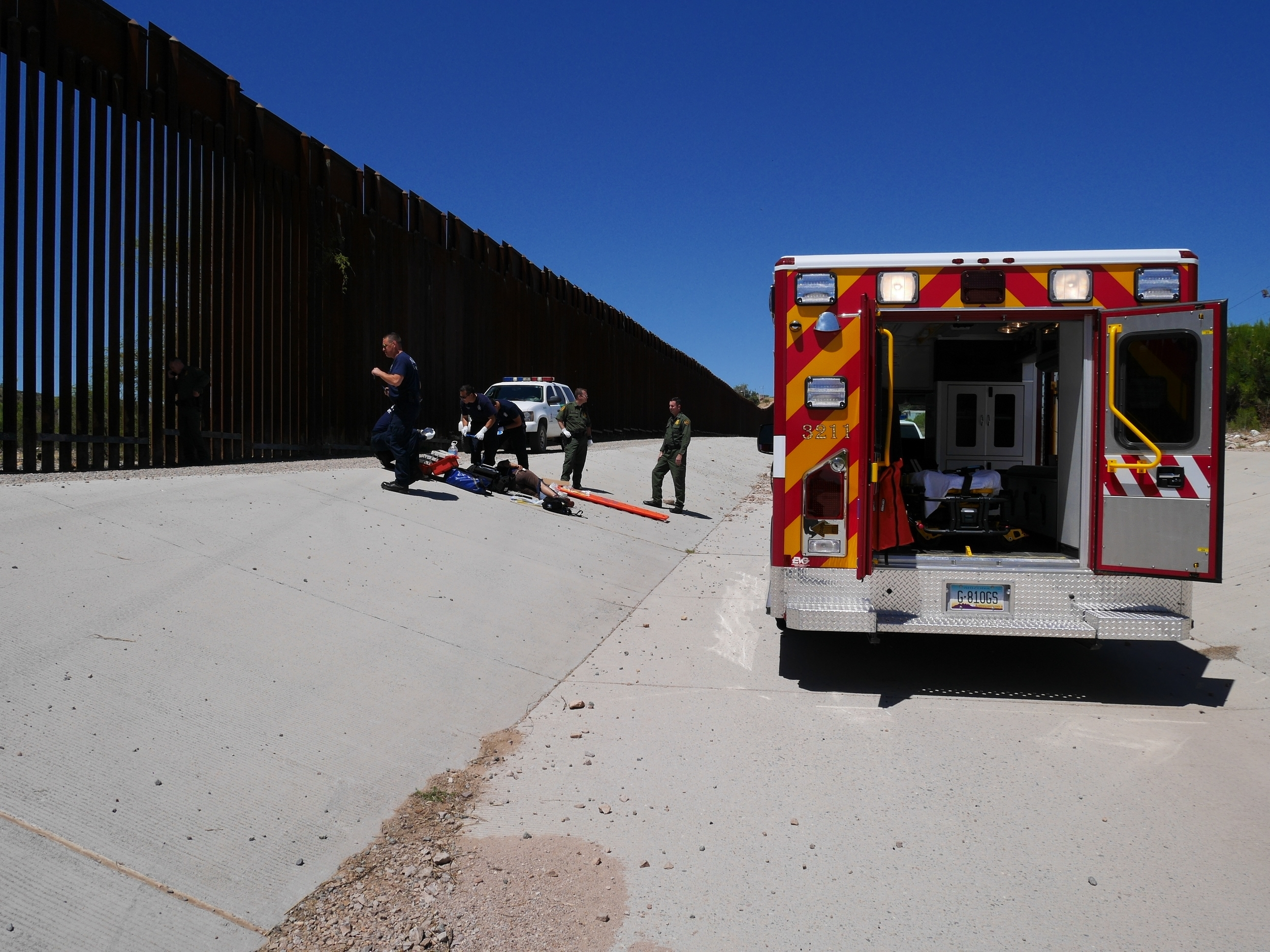 Paramedics from the Nogales Fire Department provide emergency care to an injured woman who fell off the border fence. May 2015. Photo by Ieva.