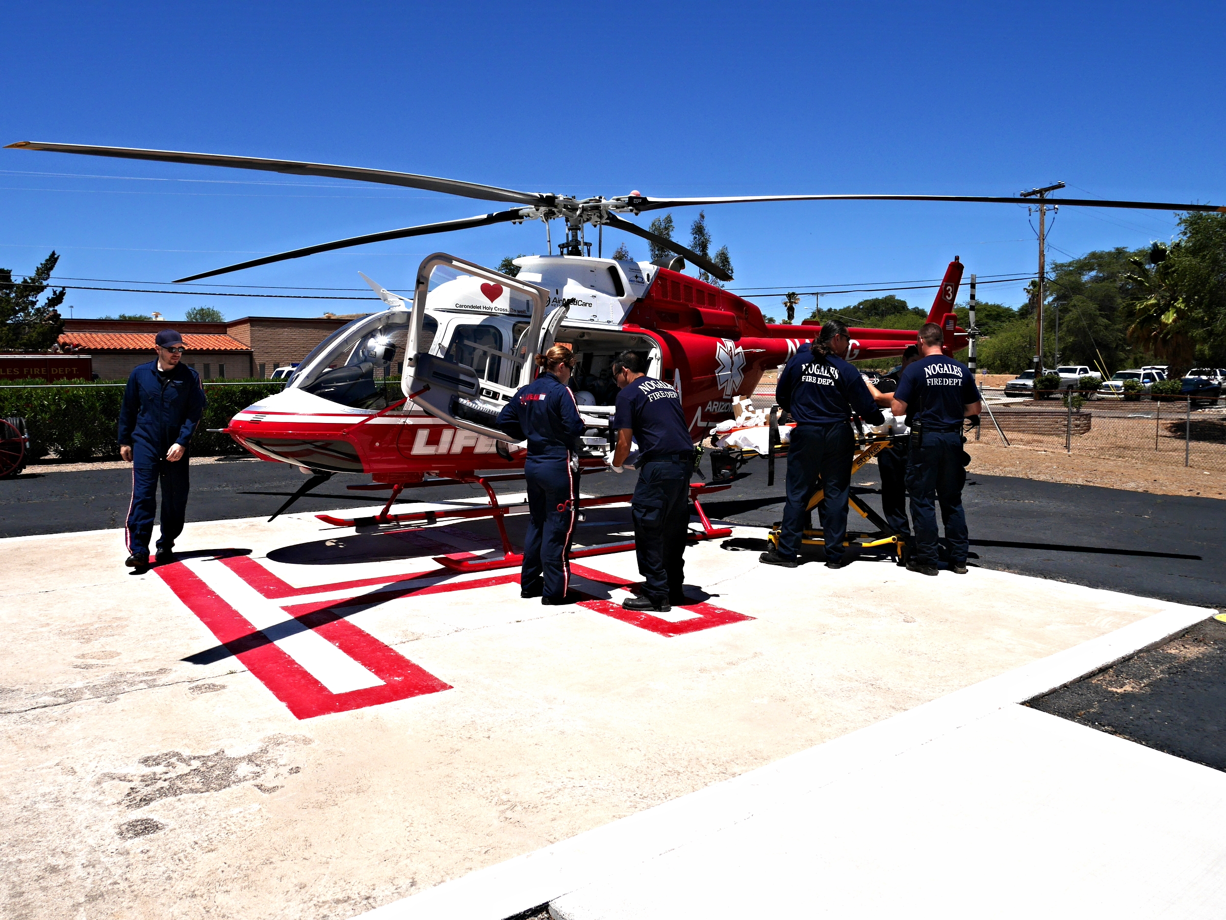Patient being transferred onto LifeLine helicopter at the landing pad near Nogales Holy Cross Hospital. May 2015. Photo by Ieva.