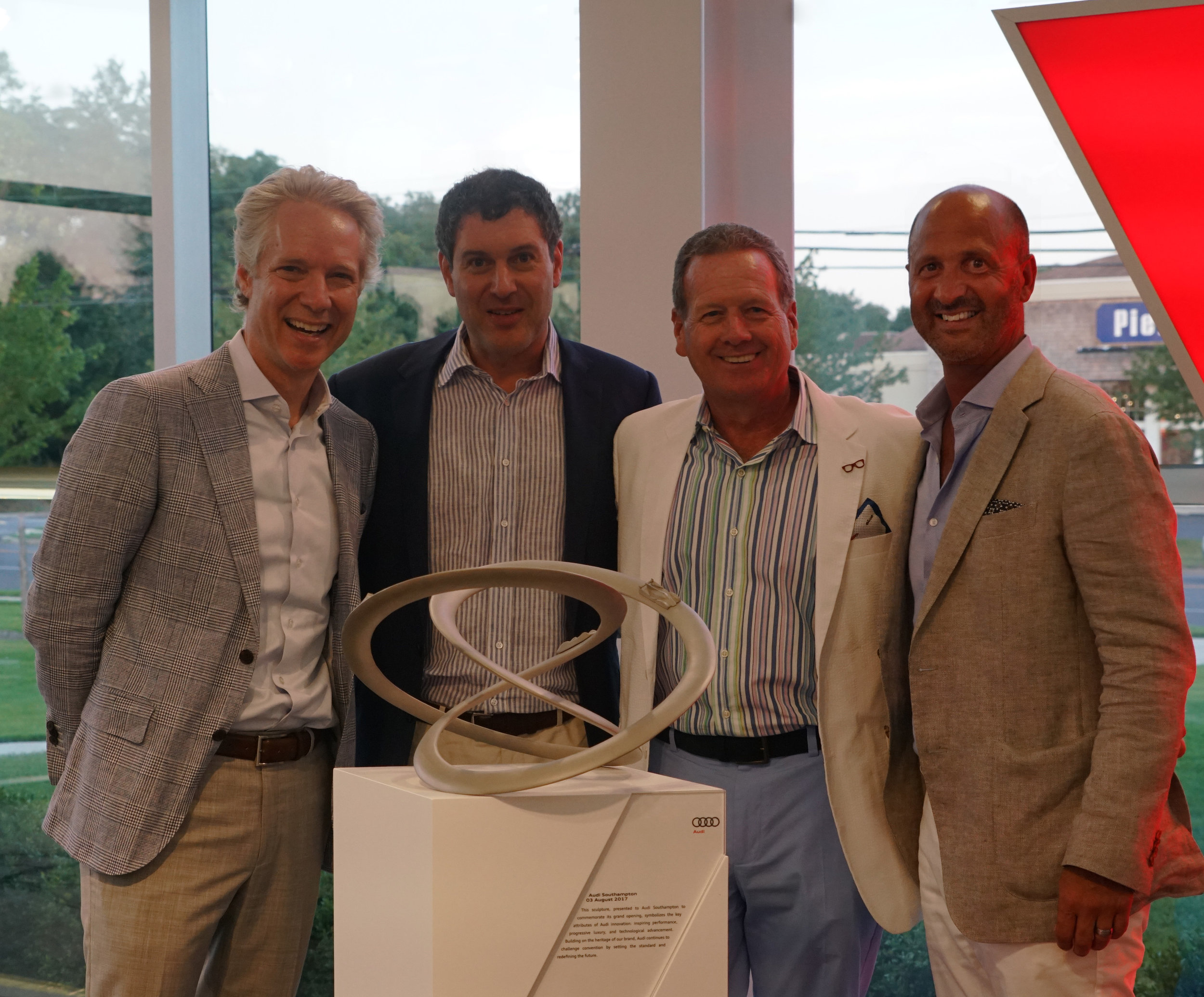 Audi President Scott Keogh presents honorary statue to commiserate the Grand Re-opening for @AudiSouthampton -