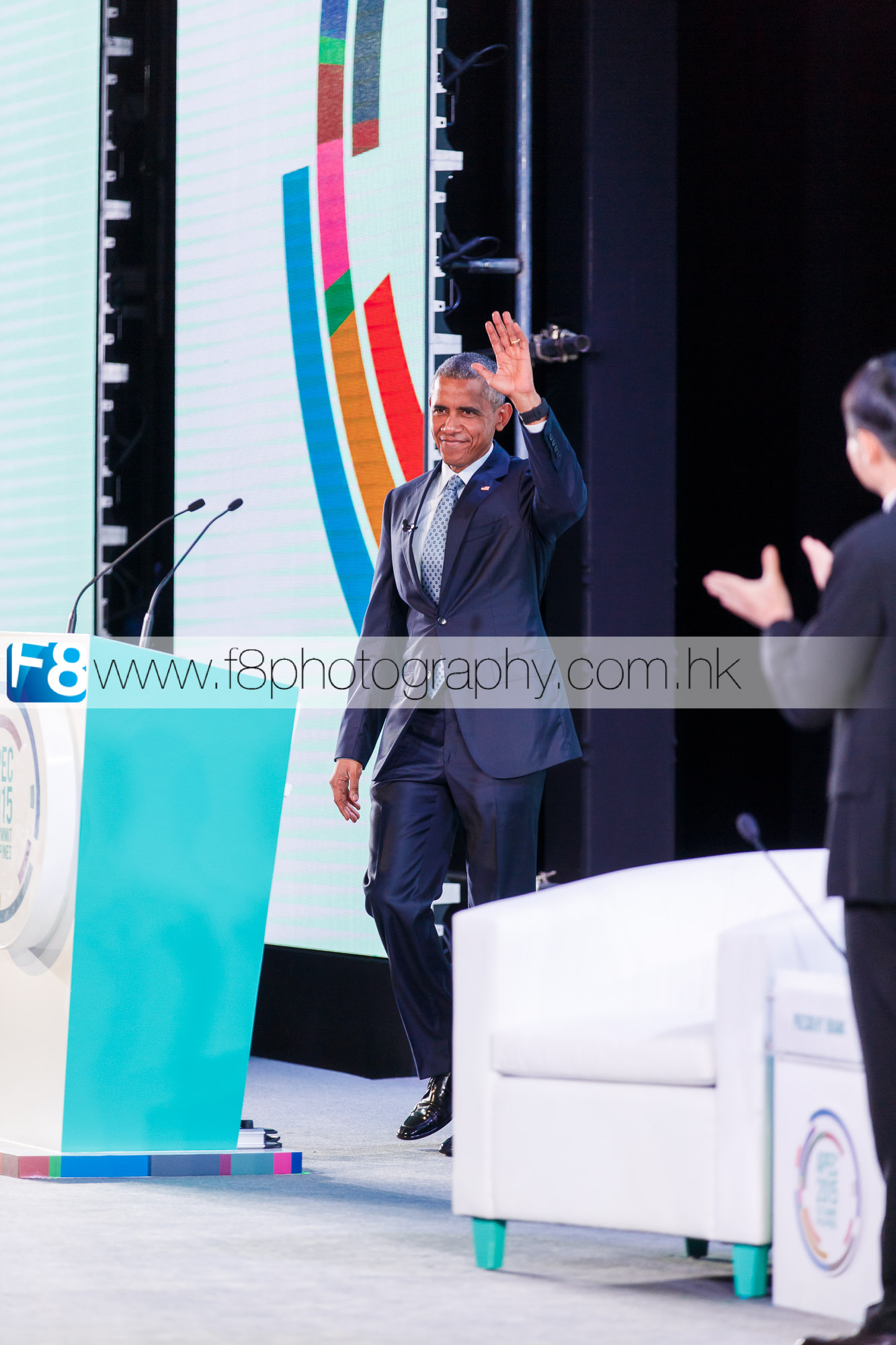 President Barack Obama arriving on stage to greet the 2015 APEC guests.