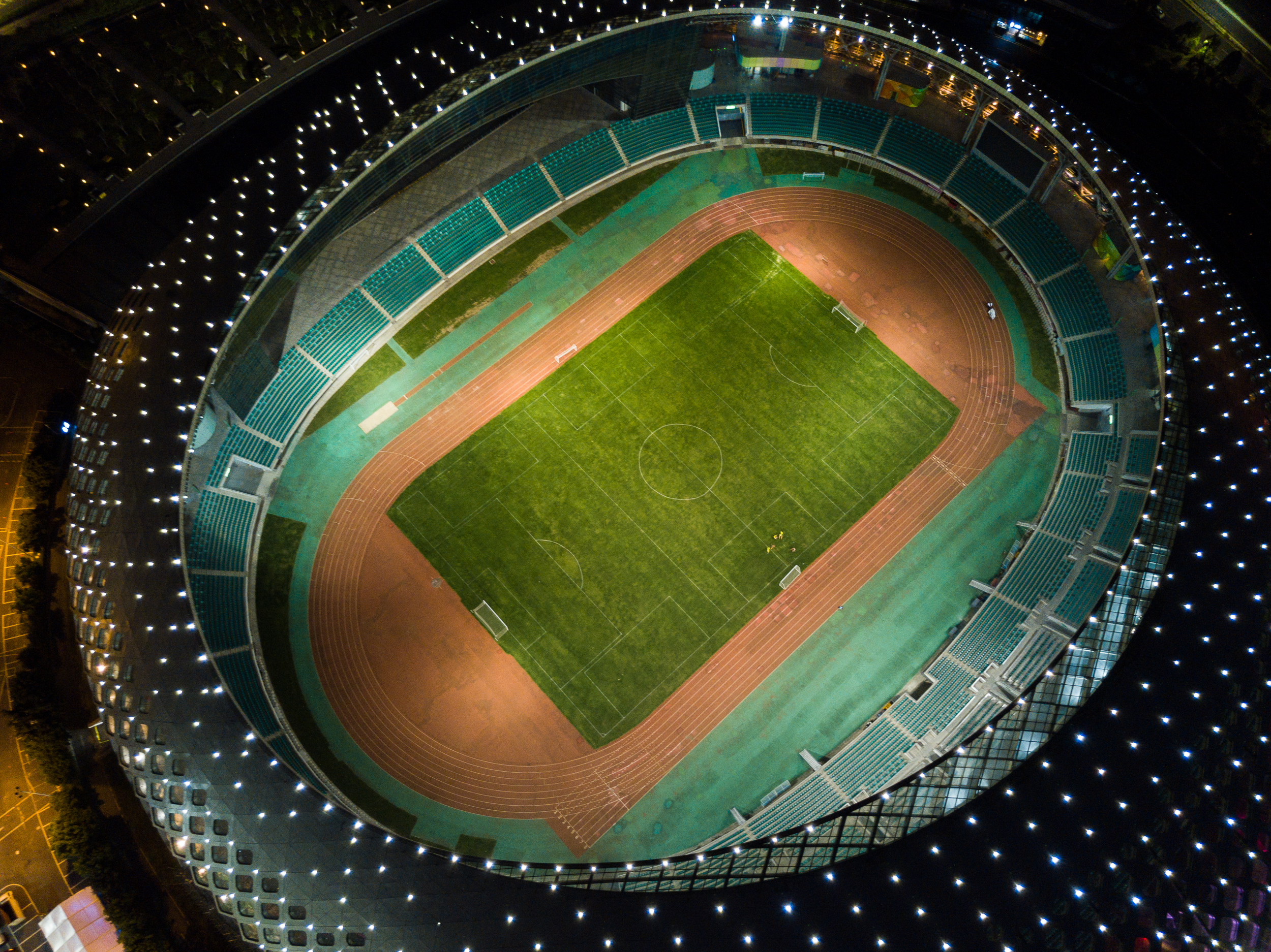 Night view of the Shenzhen Bay Sports Centre Football pitch.
