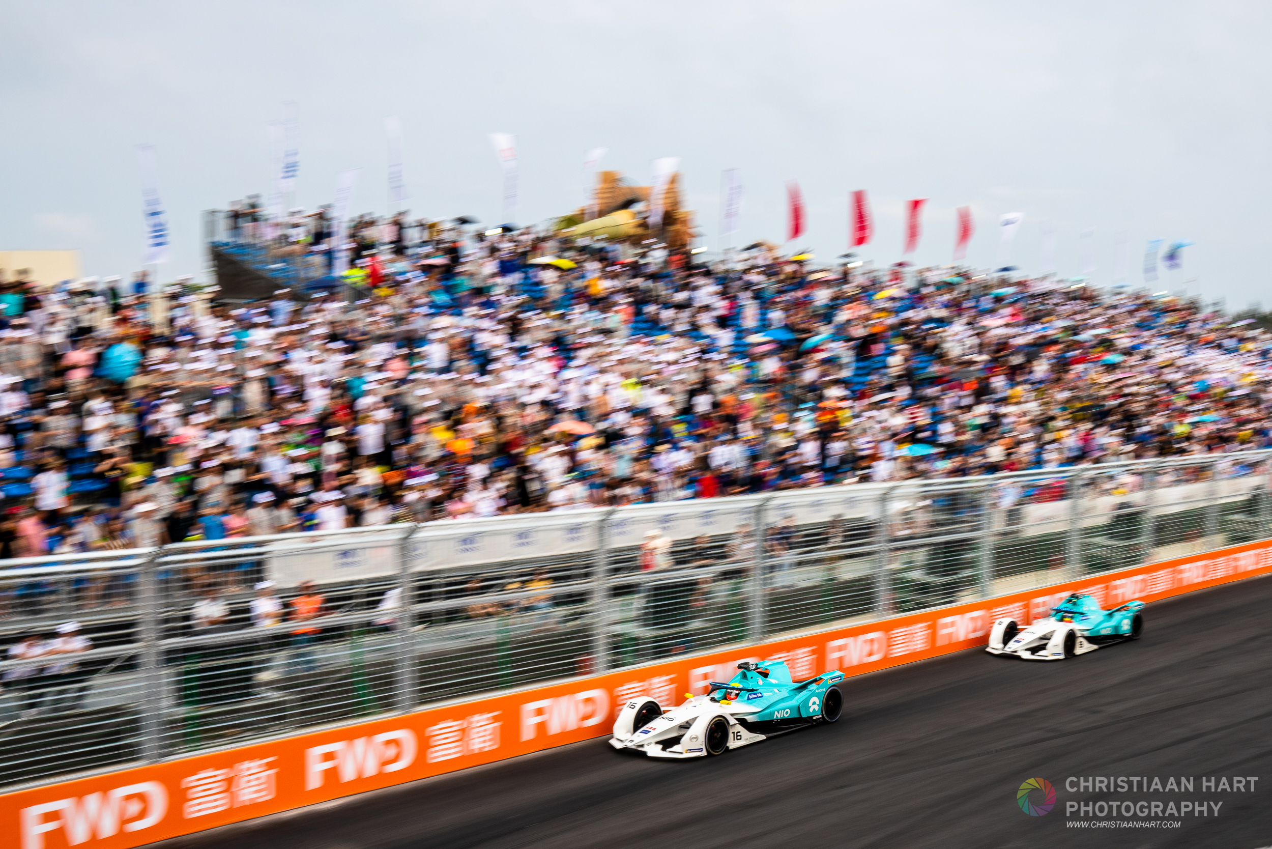 Local fans enjoyed the warm conditions at Sanyas first Formula E race.  NIO Formula E team  tackles the track in formation.