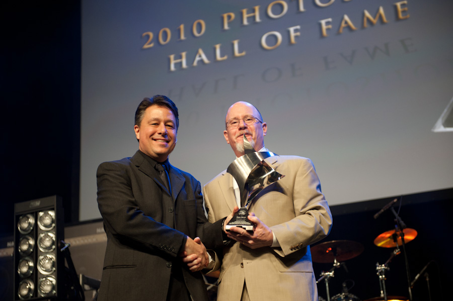Peter (R) being presented with his award by KelbyOne's Larry Becker during the induction ceremony as part of the opening keynote presentation at the Photoshop World Conference & Expo