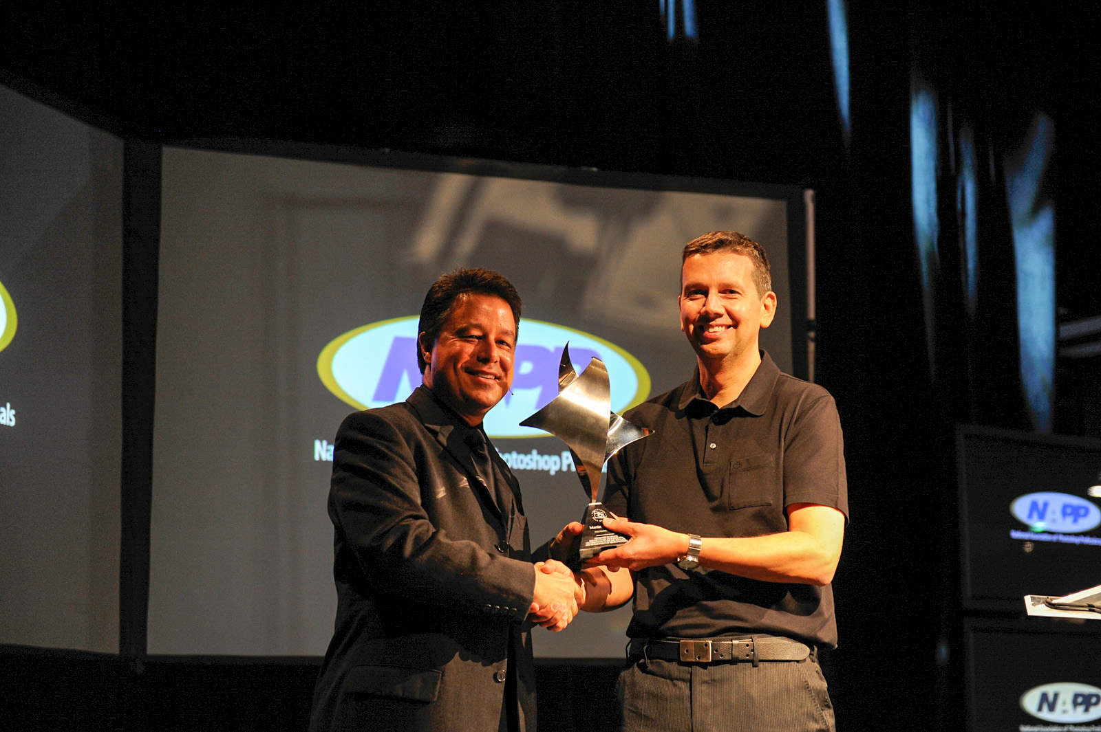 Martin (R)accepting his Photoshop Hall of Fame from NAPP's Larry Becker (L) on stage during the opening keynote presentation at the Photoshop World Conference & Expo.