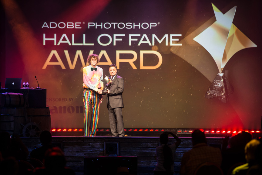 Russell (R) accepting the Hall of Fame Award during the Photoshop World opening keynote