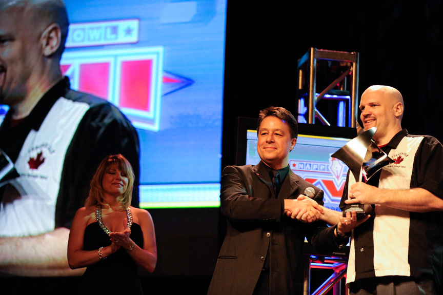 Dave (R) receiving his award from Larry Becker (L) during the Photoshop World Conference & Expo opening keynote presentation.
