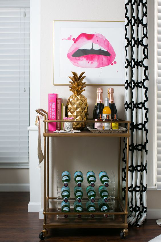inspiration station - I've been dreaming of a bar cart for too darn long -- re: the dozens upon dozens of setups I've pinned. Seeing this bold lip print and pineapple, along with the pops of pink, has me utterly convinced I need to redesign my apartment ASAP. Also, that bottle holder *heart eyes*. When sad, try to dream a little, even if it's about bar carts.