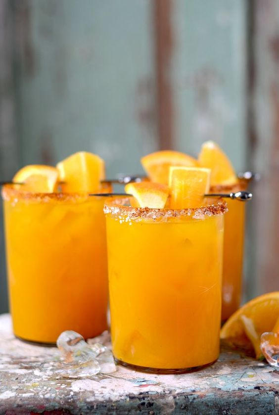 orange turmeric margs - When I'm sad, I spend time planning parties -- weddings for my friends, my best friend's birthday bashes, cozy dinner parties. Sometimes, I create them around cocktail recipes. This recipe makes me think of a simple Saturday afternoon with girlfriends. Mix up a batch of these margaritas to go with some mango pineapple salsa, blue corn tortilla chips, and a playlist that has you wanting to dance. Decorations not required.