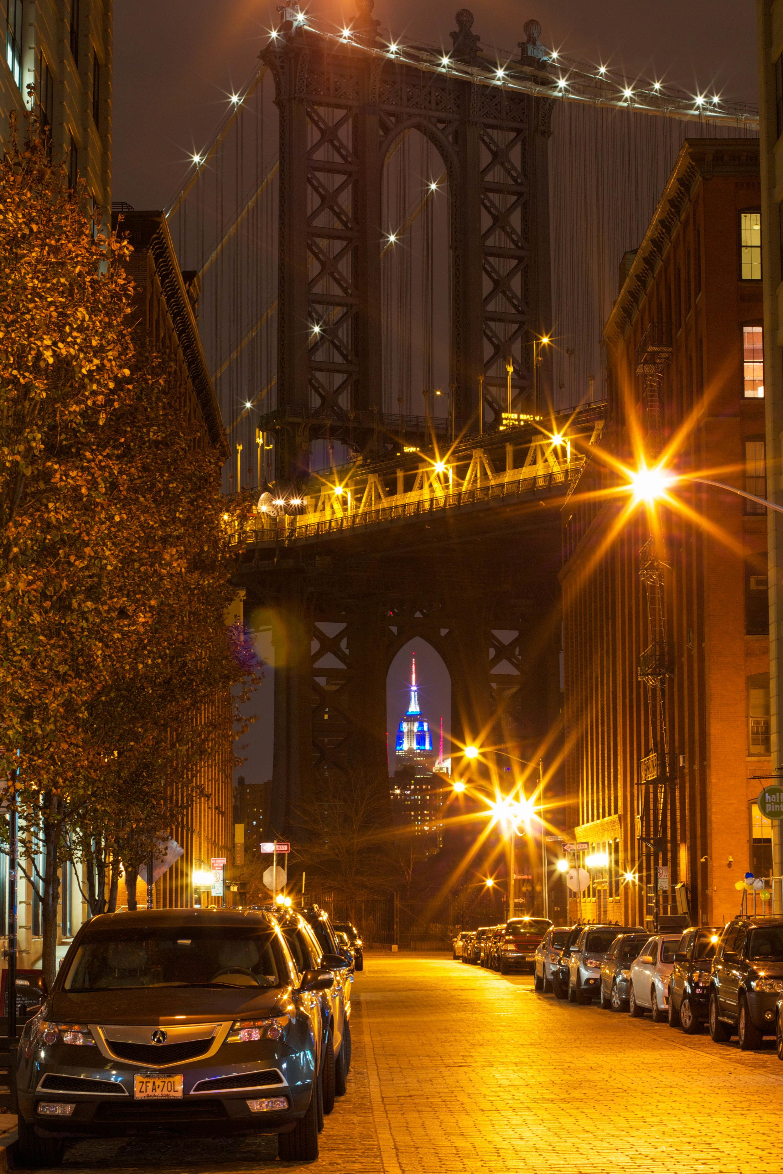 The cliche Manhattan through the Brooklyn Bridge shot