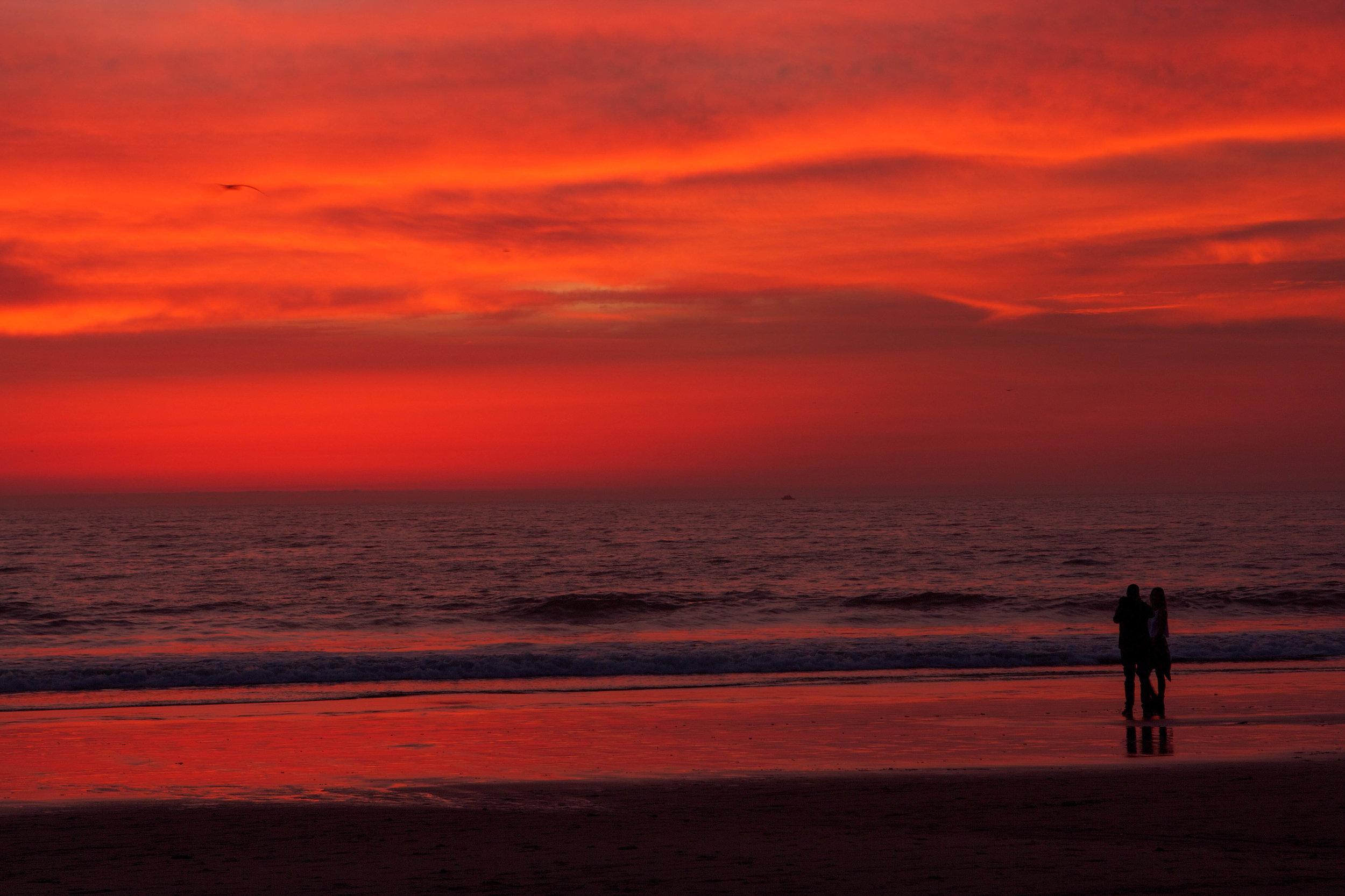 A couple breaks up at the beach. Santa Monica, CA